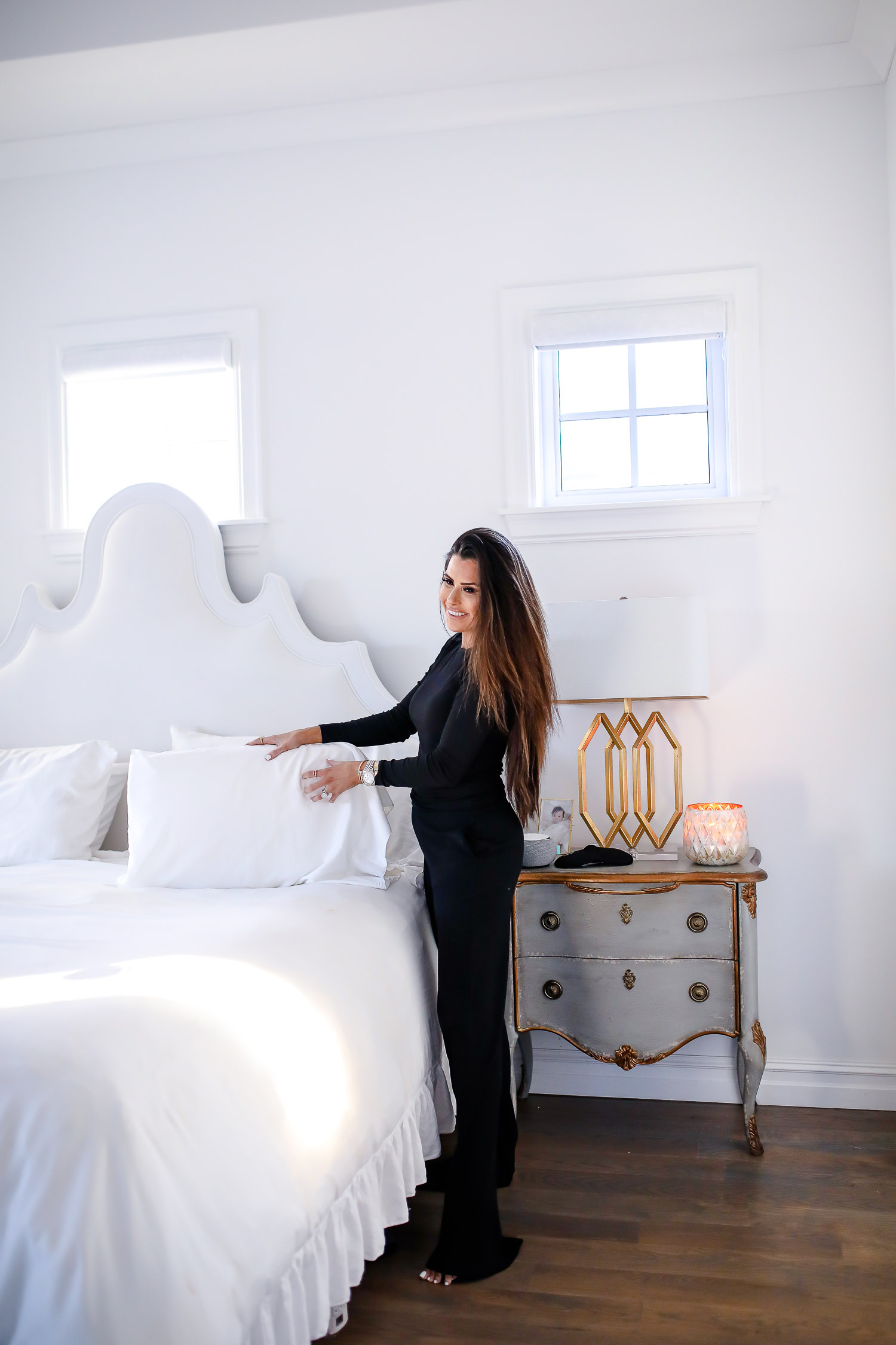 verishop, verishop review, pinterest master bedroom inspo, emily gemma, hooker furniture nightstands-2 | Cozy Essentials by popular US fashion blog, The Sweetest Thing: image of a woman standing by her bed and wearing a Verishop LETT Montreal Rib Top and Verishop LETT Heathrow Wide Leg Pant.