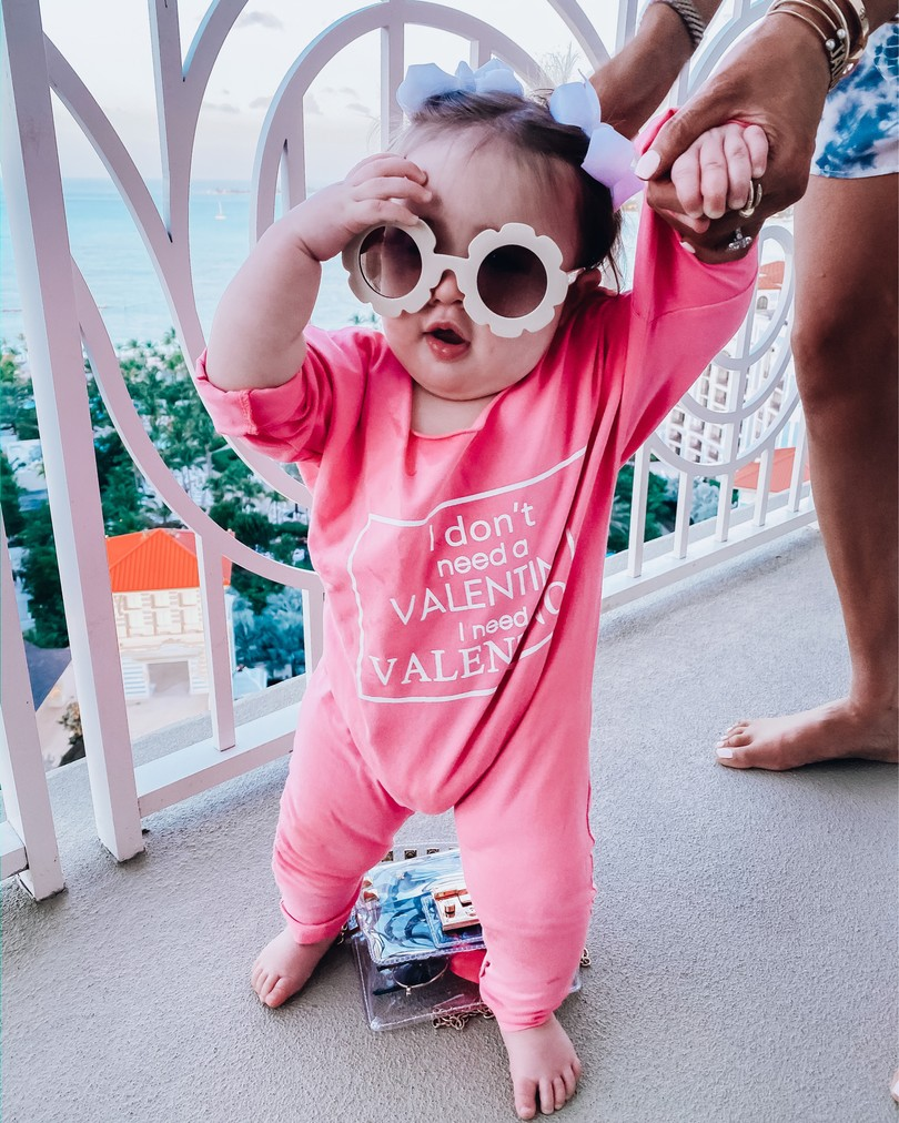 "Instagram Fashion by popular US fashion blog, The Sweetest Thing: image of a baby wearing a Amazon Fheaven baby Girls""i don't need a valentine i need valentino"" Long Sleeve Romper Jumpsuit, Amazon Roll over image to zoom in ADEWU Sunglasses for Kids Round Flower Cute Glasses UV 400, and Amazon Korobeauty Hair Bows Baby Girls."