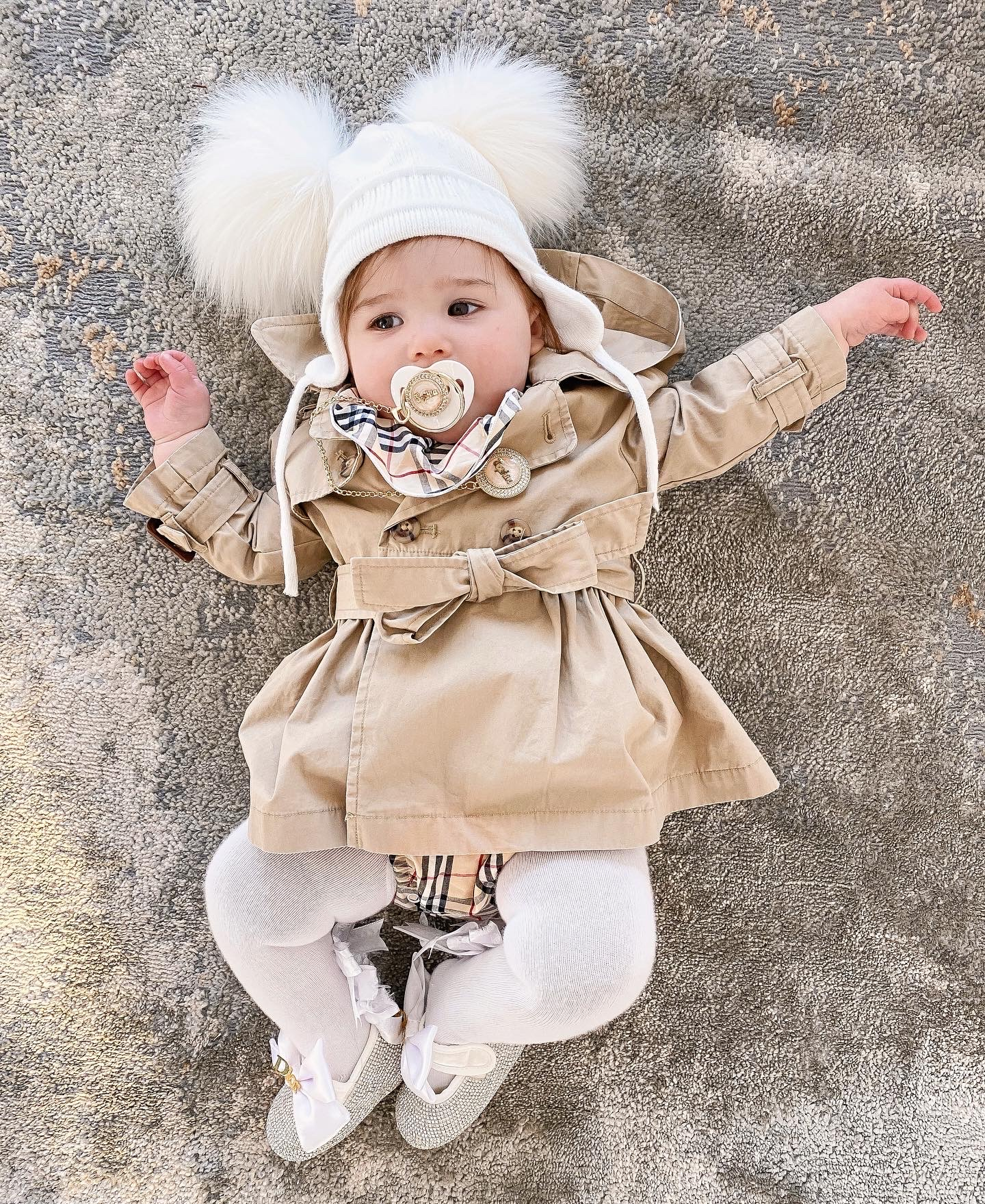 Instagram Recap by popular US fashion blog, The Sweetest Thing: image of a baby wearing a Ralph Lauren trench coat, Etsy Minilittlebaby Gold Pleated Personalised DUMMY AND Chain pacifier, Etsy Minilittlebaby Pacifier Clip, Etsy Minilittlebaby personalized Pearl Baby Girl shoes, and Gap Toddler Cable-Knit Pom Beanie.