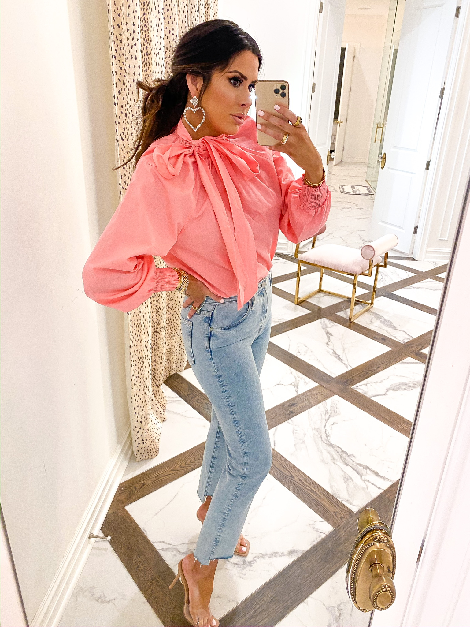 Instagram Fashion by popular US fashion blog, The Sweetest Thing: image of a woman wearing a Nordstrom Topshop Pussybow Poplin Blouse, Nordstrom The Isabelle High Waist Step Hem Ankle Jeans AG, ASOS True Decadence rhinestone crystal heart drop earrings, and Steve Madden SIGNAL CLEAR heels.