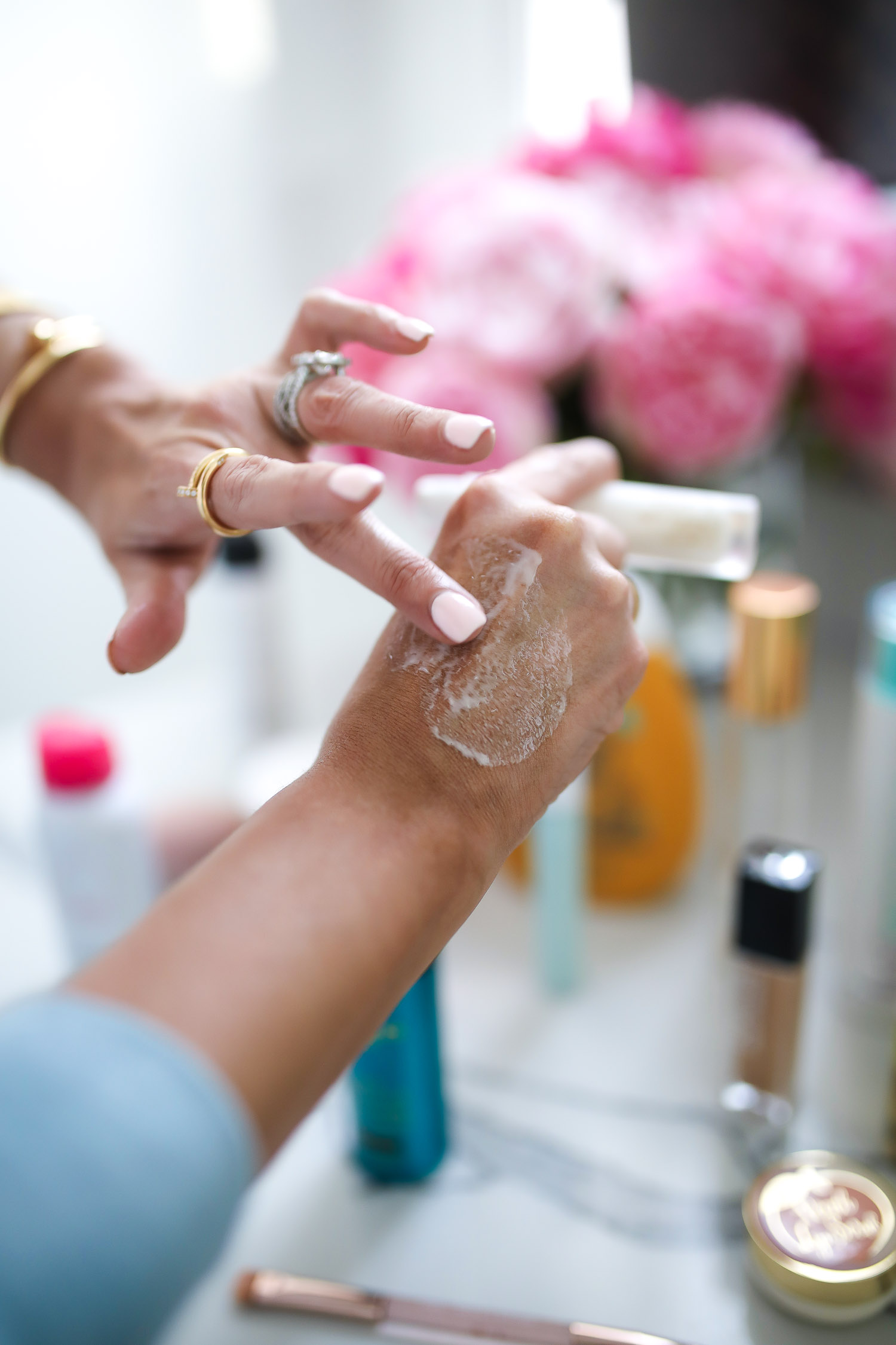 Sephora Favorites by popular US beauty blog, The Sweetest Thing: image of a woman applying a cream to her hand.