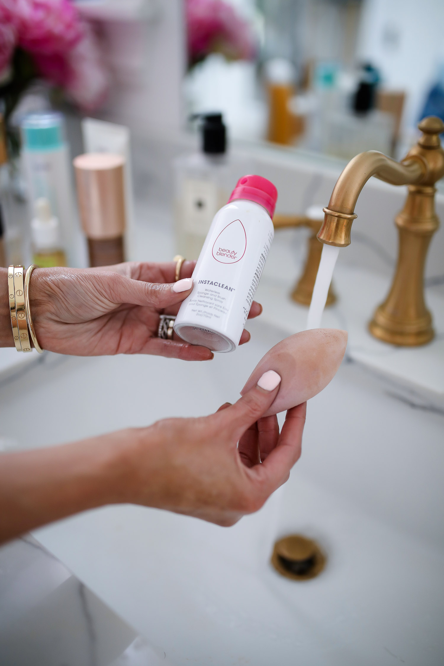 Sephora Favorites by popular US beauty blog, The Sweetest Thing: image of a woman holding a beauty blender and a bottle of beauty blender cleaner.