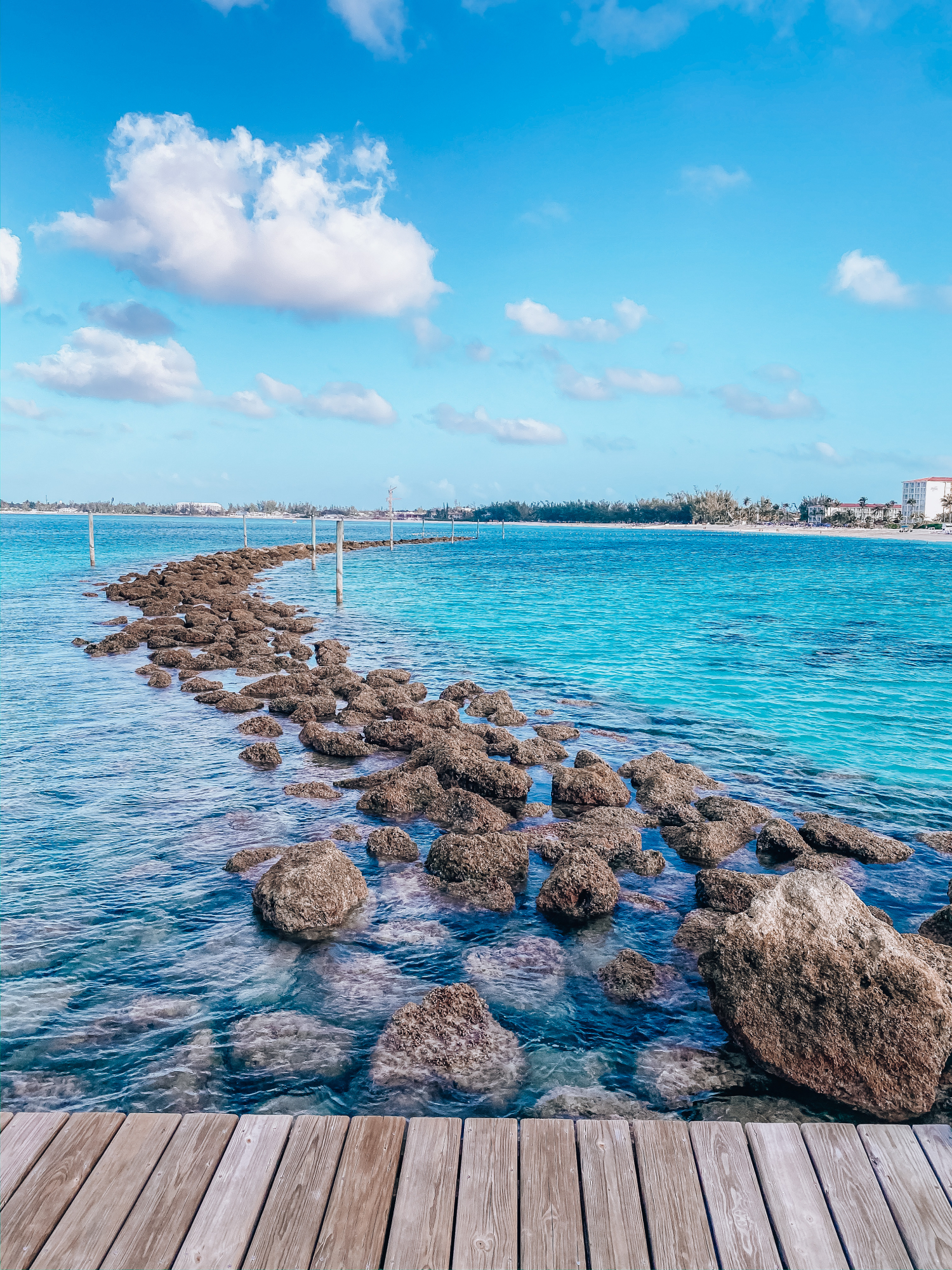 bahamas bahamar water view review | What to Wear in the Bahamas by popular US travel blog, The Sweetest Thing: image of pier and the Caribbean ocean.