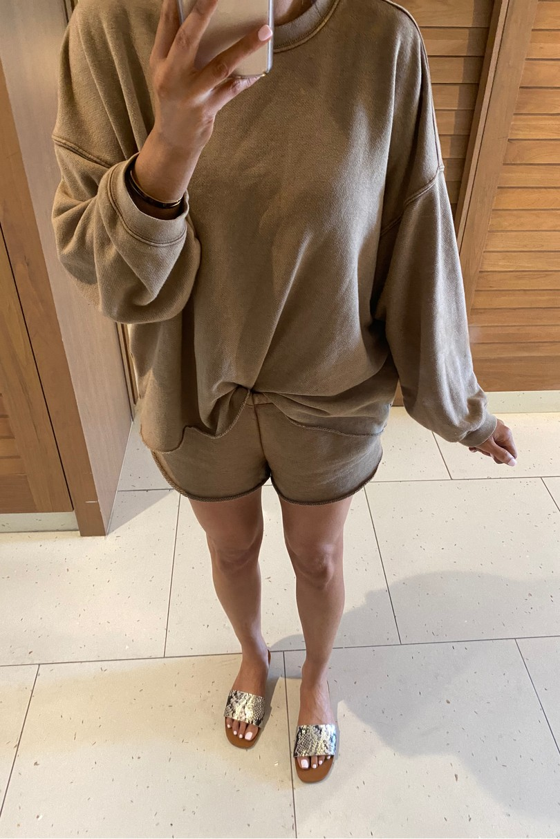 Instagram Fashion by popular US fashion blog, The Sweetest Thing: image of a woman wearing a Aerie AERIE SUNDAY SOFT OVERSIZED SWEATSHIRT, Aerie shorts, and Steve Madden NIKINI GOLD SNAKE slides.