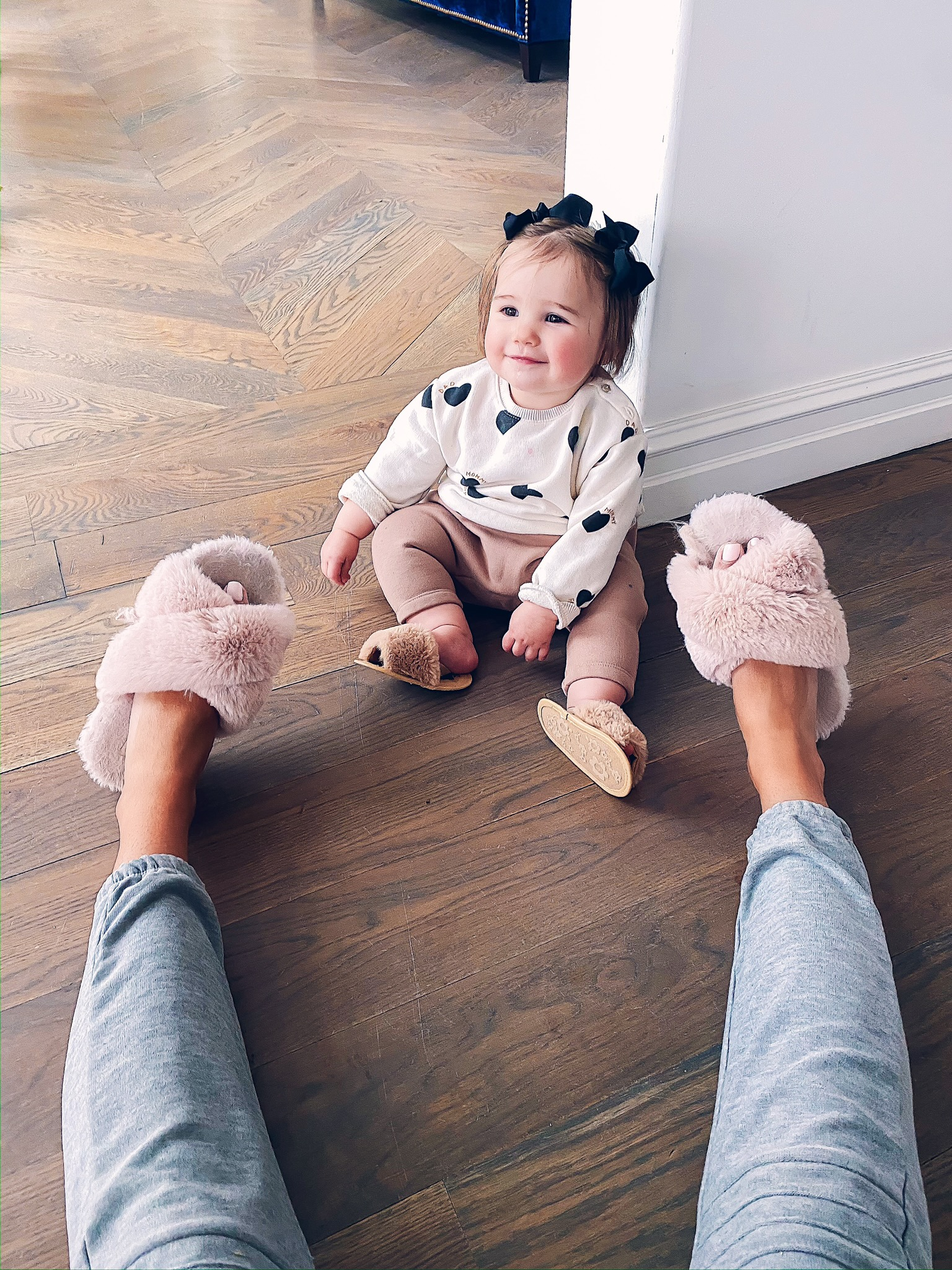 Instagram Recap by popular US lifestyle blog, The Sweetest Thing: image of a mom and daughter sitting on the floor and wearing a Nordstrom Moto Cozy Jogger Pants CHASER, Amazon HALLUCI Women's Cross Band Soft Plush Fleece House Indoor or Outdoor Slippers, Amazon KoroBeauty Hair Bow, and Amazon BLKCERY Baby Sandals for Girls Summer Shoes Faux Fur Slippers.