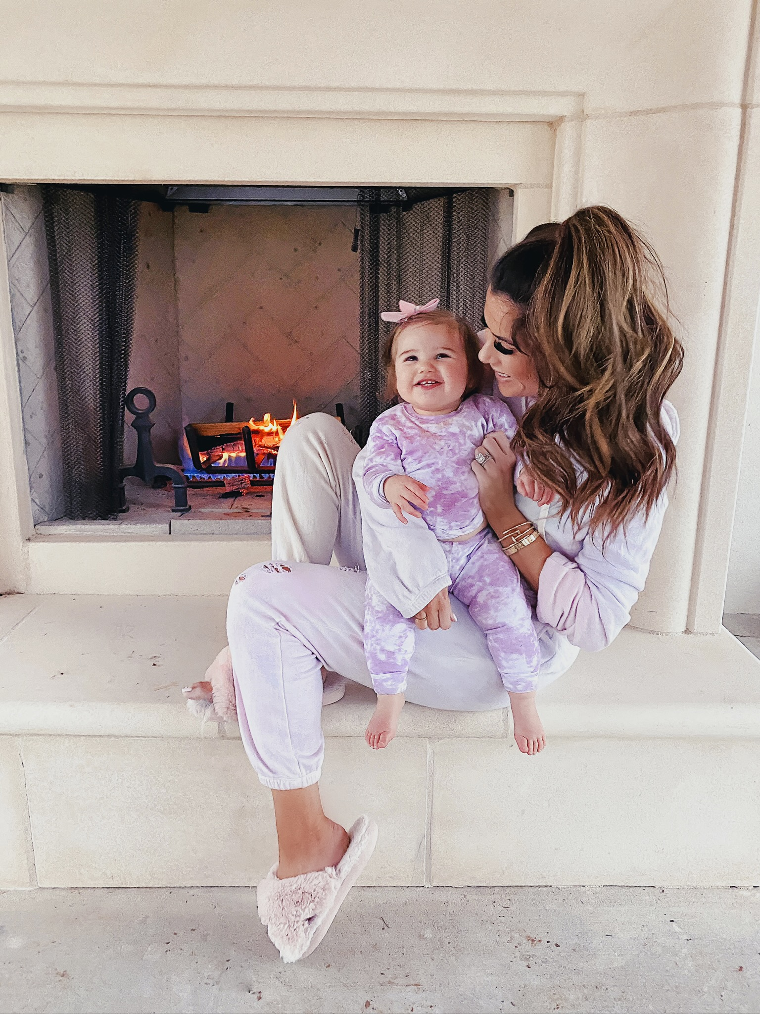 Comfortable Loungewear by popular US fashion blog, The Sweetest Thing: image of Emily Gemma wearing a Z Supply The Pale Blush Rugby Stripe Weekender Sweater and Nordstrom Zella leggings.| Comfortable Loungewear by popular US fashion blog, The Sweetest Thing: image of Emily Gemma and her daughter Sophie wearing a n:philanthropy GAMBLE SWEATSHIRT, n: philanthropy DERBY JOGGER, Amazon HALLUCI Women's Cross Band Soft Plush Fleece House Indoor or Outdoor Slippers, and Amazon VAENAIT BABY 12M-12 Toddler Kids Boys Girls 100% Cotton Marbling Sung Fit Sleepwear Pajamas.