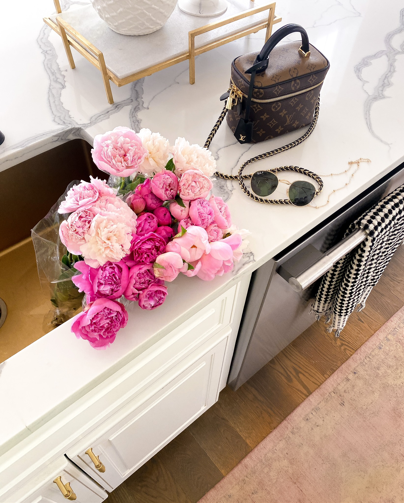 Instagram Recap by popular US lifestyle blog, The Sweetest Thing: image of a pair of Nordstrom Icons 53mm Retro Sunglasses RAY-BAN, Francesca's Nelly Heart Sunglass Chain, Wayfair Dunbar Accent Tray, Anthropologie Wanderer Towel Collection Set, and RugsUSA Pink Allurance Medallion Fringe Area Rug.