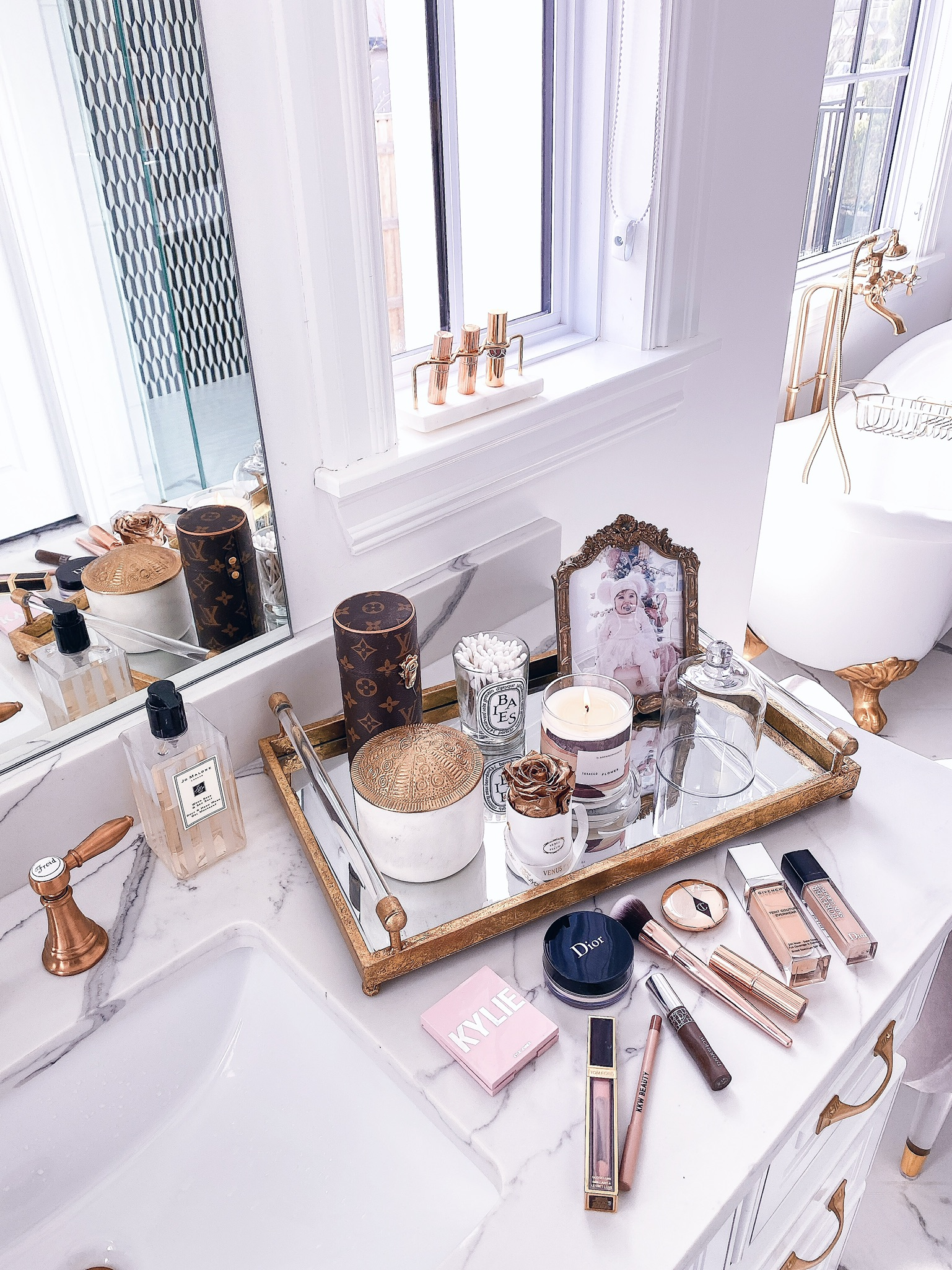 Instagram Recap by popular US lifestyle blog, The Sweetest Thing: image of a Anthropologie Victoria Frame, Anthropologie Huntington Marble Canister, Anthropologie Coraline Vanity Mirror, Anthropologie Marble Vanity Organizer, Overstock Carter Antiqued Gold Decorative Trays, Anthropologie Cloche Candle, and Nordstrom Peony & Blush Suede Body & Hand Wash JO MALONE LONDON.