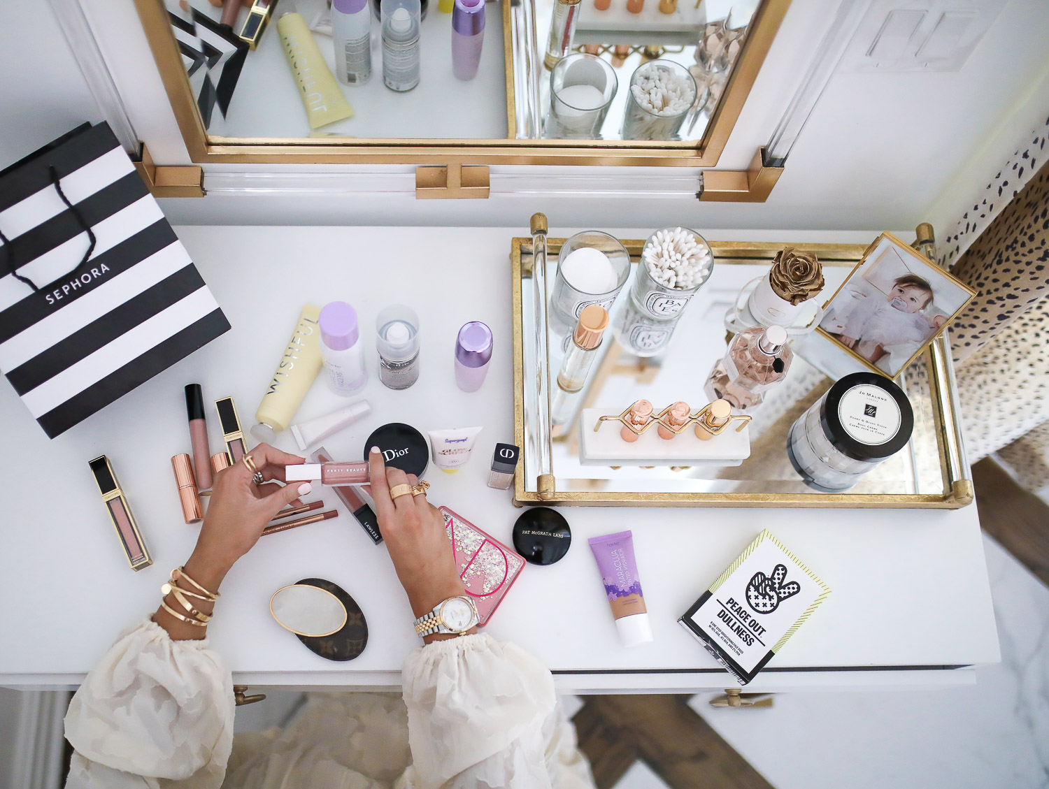 Sephora Haul spring 2020, beauty bloggers, Tatcha Liquid Silk Canvas review, lawless makeup review, emily gemma | Sephora Favorites by popular US beauty blog, The Sweetest Thing: image of a vanity with a Sephora bag and various Sephora makeup products on it.