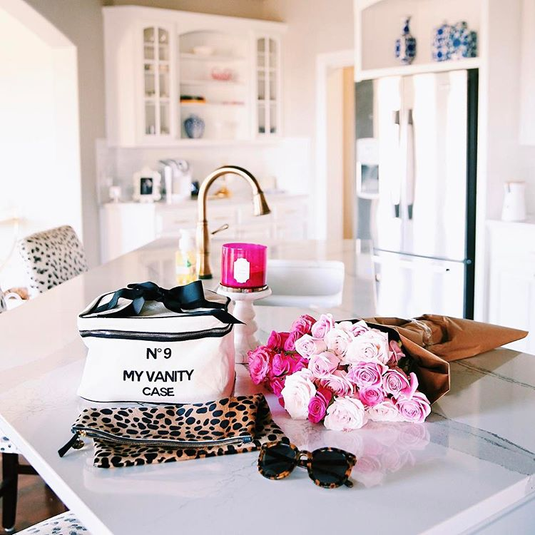 ShopBop Sale by popular US fashion blog, The Sweetest Thing: image of a woman wearing a ShopBop Bag-all My Vanity Travel Case and ShopBop Karen Walker Alternative Fit Super Duper Strength Sunglasses.