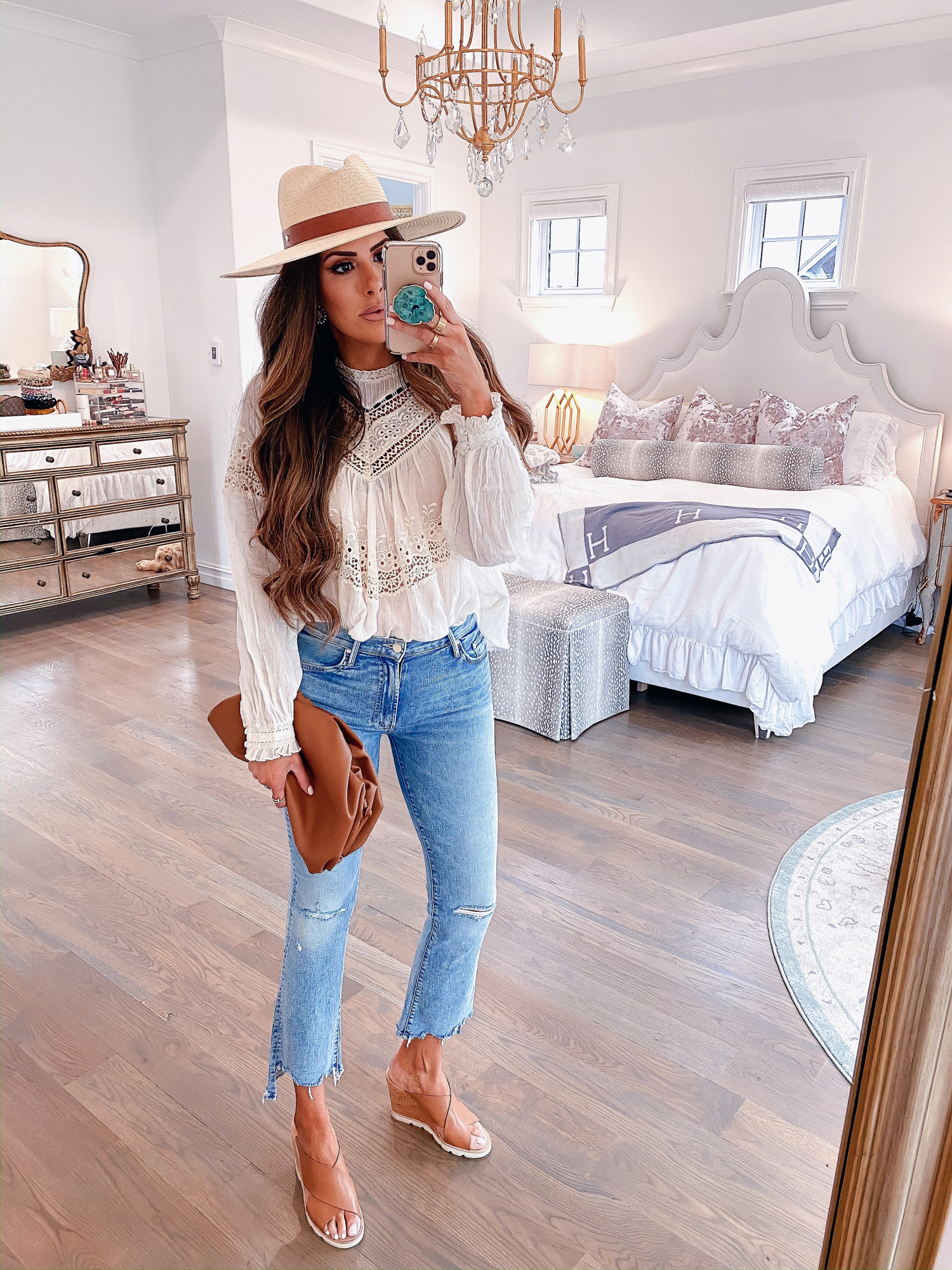 Instagram Recap by popular US lifestyle blog, The Sweetest Thing: image of Emily Gemma wearing a Free People top, Nordstrom Mother The Insider Ripped Chew Hem Crop Bootcut Jeans, PORT BUTTON STUD EARRINGS, Nordstrom Wide Brim Panama Hat RAG & BONE, Nordstrom Pillow Talk Lip Cheat Lip Liner CHARLOTTE TILBURY, Nordstrom Hot Lips Lipstick CHARLOTTE TILBURY, Nordstrom Gloss Luxe Moisturizing Lipgloss TOM FORD, Steve Madden FLORETTA COGNAC LEATHER wedges, and holding a Net-A-Porter BOTTEGA VENETA The Pouch small gathered leather clutch.