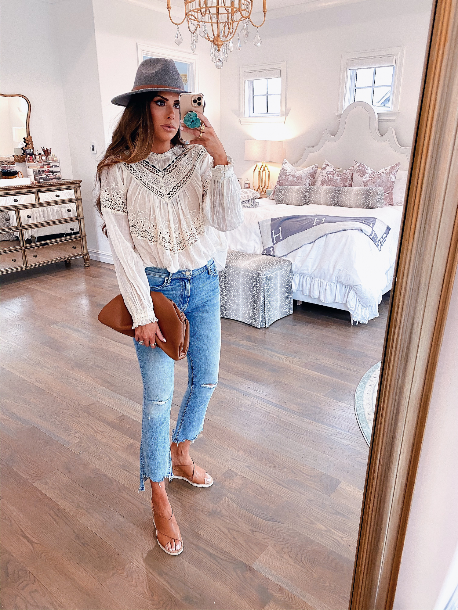 Instagram Recap by popular US lifestyle blog, The Sweetest Thing: image of Emily Gemma wearing a Free People top, Nordstrom Mother The Insider Ripped Chew Hem Crop Bootcut Jeans, PORT BUTTON STUD EARRINGS, Free People Wythe Leather Band Felt Hat, Nordstrom Pillow Talk Lip Cheat Lip Liner CHARLOTTE TILBURY, Nordstrom Hot Lips Lipstick CHARLOTTE TILBURY, Nordstrom Gloss Luxe Moisturizing Lipgloss TOM FORD, Steve Madden FLORETTA COGNAC LEATHER wedges, and holding a Net-A-Porter BOTTEGA VENETA The Pouch small gathered leather clutch.