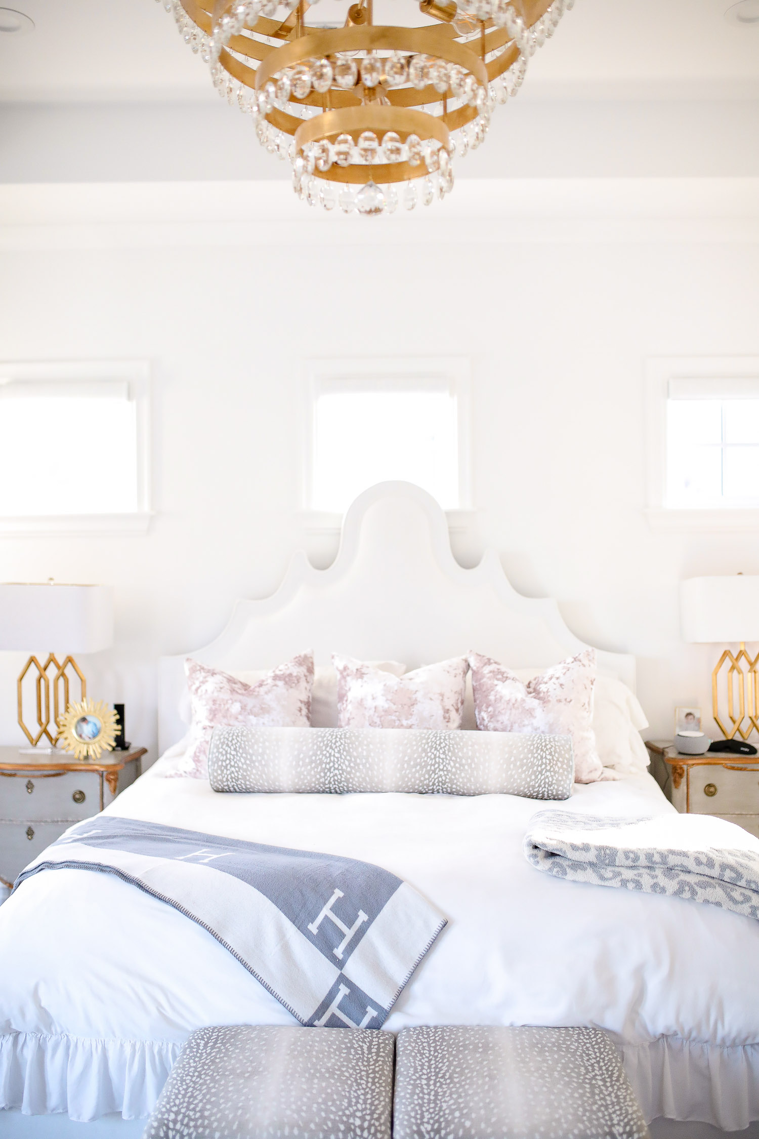 Instagram Recap by popular US lifestyle blog, The Sweetest Thing: image of a bedroom decorated with a Wayfair nightstand, Wayfair Meela Queen Standard Bed, Horchow Prescott Triple Table Lamp, Etsy Lavish Velvet // Mist Pillow COVER, Etsy The Little Bolster : Antelope Linen Print, Nordstrom Leopard Throw Blanket NORDSTROM, Wayfair Buckhead 6-Light Candle Style Classic / Traditional Chandelier, Horchow Crystorama Perla 5-Light Chandelier, and Etsy The Skirted Ottoman : Antelope Linen Print.