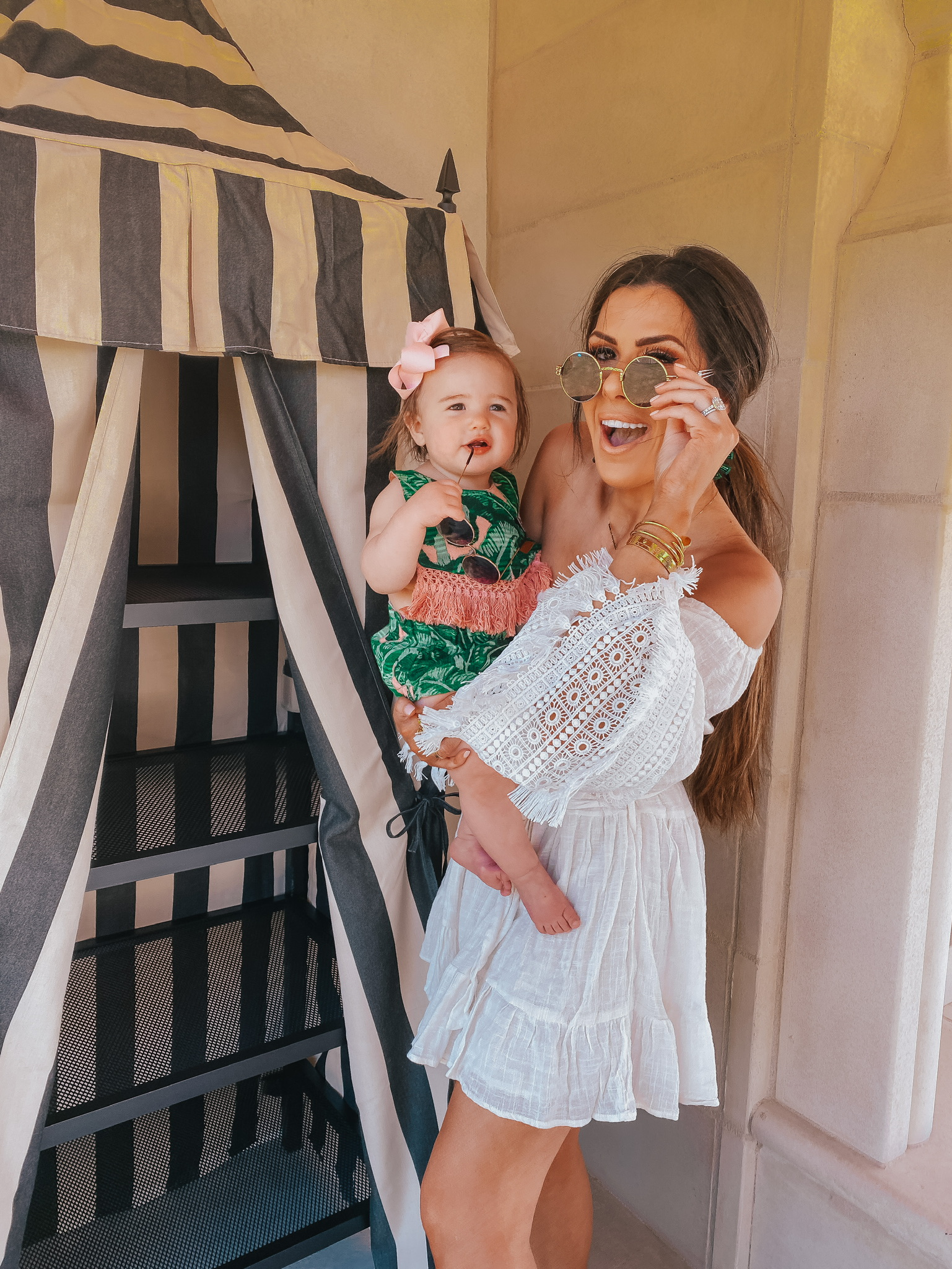 Instagram Recap by popular US lifestyle blog, The Sweetest Thing: image of Emily Gemma holding her daughter and wearing a Red Dress She's The One Ivory Eyelet Lace Dress, Judith March PALM SPRINGS DREAM STATEMENT EARRING, Nordstrom 48mm Round Metal Sunglasses BP., Judith March TROOP PALM SPRINGS BIB & DIAPER COVER, Amazon Roll over image to zoom in SA106 Kids Child Size Hippie Round Circle Lens Tie Dye Gradient Metal Sunglasses, and Amazon Korobeauty Hair Bow.