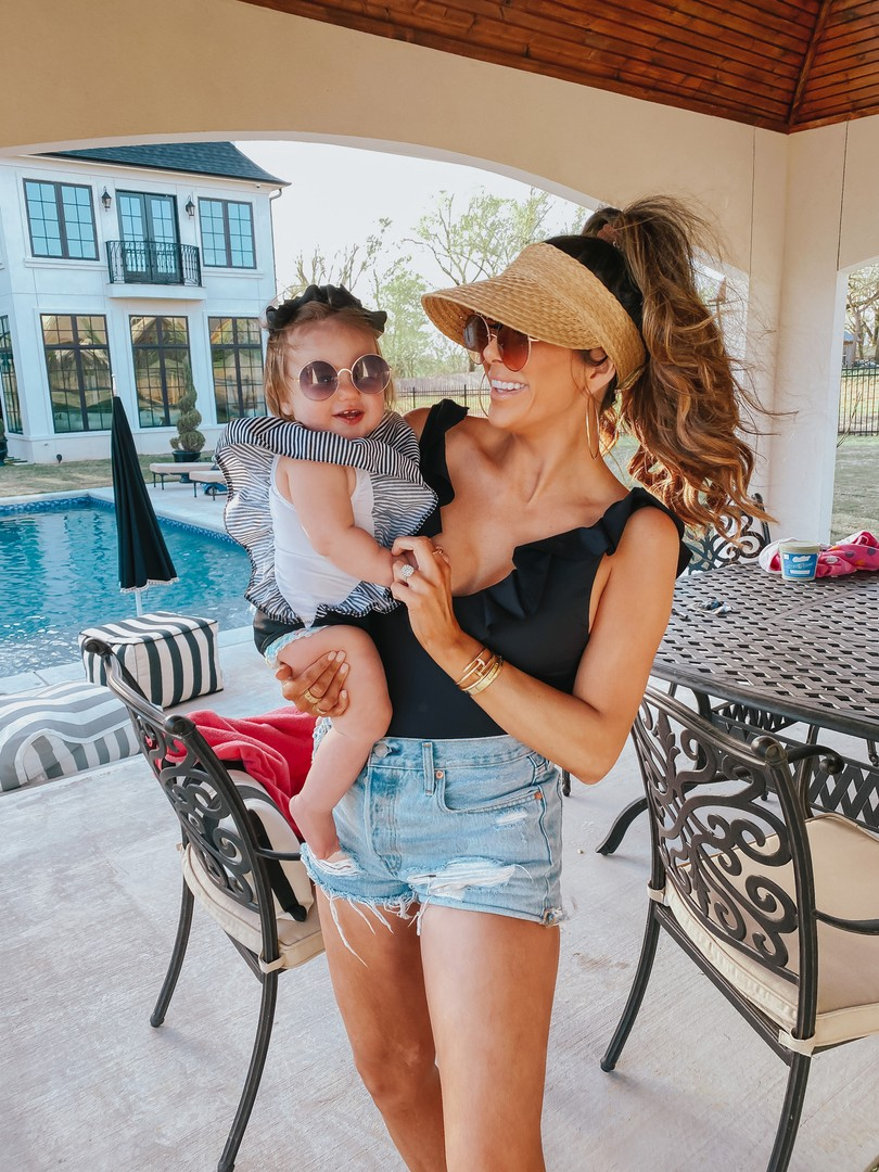 Instagram Recap by popular US lifestyle blog, The Sweetest Thing: image of Emily Gemma holding her daughter and wearing a So Solid Loreta One Piece  eberjey brand: eberjey, DIOR DIORSOCIETY2 ROUND BEADED METAL SUNGLASSES, Straw Visor BP., Shopbop One Teaspoon Hendrix Bandit Shorts, Amazon SA106 Kids Child Size Hippie Round Circle Lens Tie Dye Gradient Metal Sunglasses, Etsy One Piece Girl Swimsuit Black with Striped Ruffles, and Amazon Korobeauty Hair Bow.
