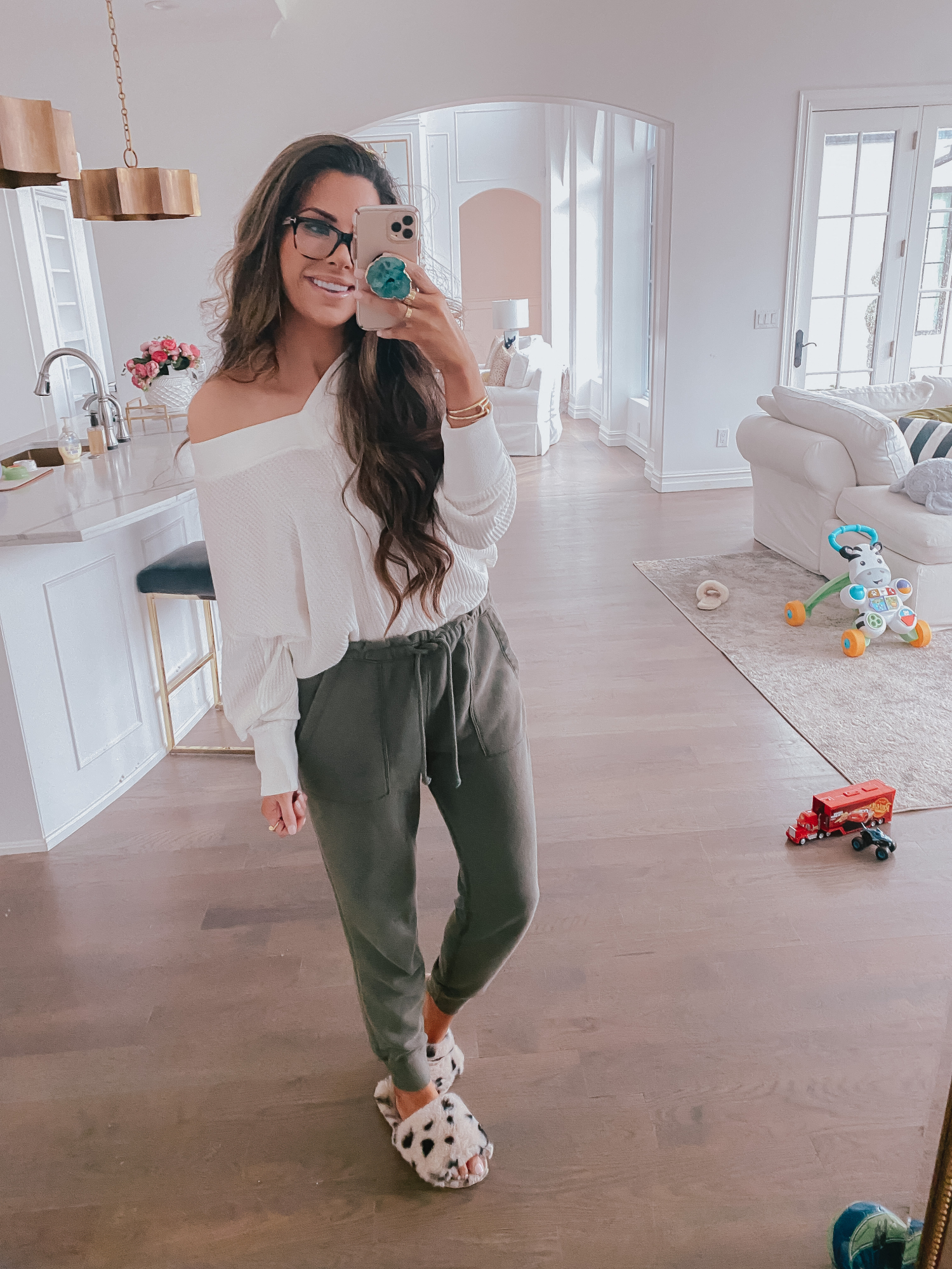 cute loungewear outfits spring 2020, quarantine outfiits, emily gemma | Comfortable Loungewear by popular US fashion blog, The Sweetest Thing: image of Emily Gemma wearing a Z Supply The Desert White Emilia Waffle Thermal Top and Abercrombie and Fitch Logo Joggers.