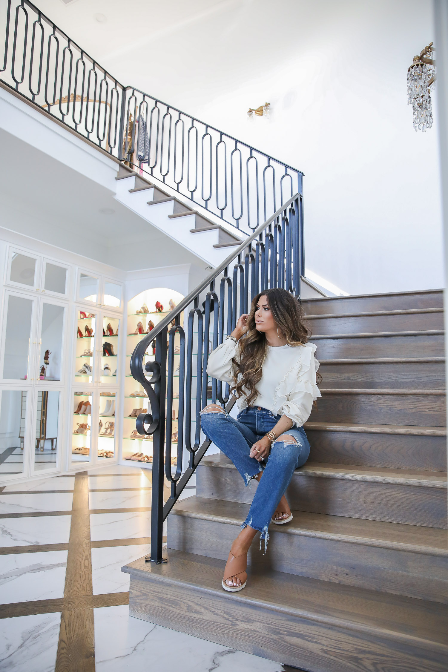 Work From Home Outfits by popular US fashion blog, The Sweetest Thing: image of Emily Gemma wearing a Express Racerback Best Loved Bra Cami, Express Chiffon Trim Crew Neck Fleece Sweatshirt, Express Large Metal Hoop Earrings and Express Super High Waisted Ripped Slim Ankle Jeans.