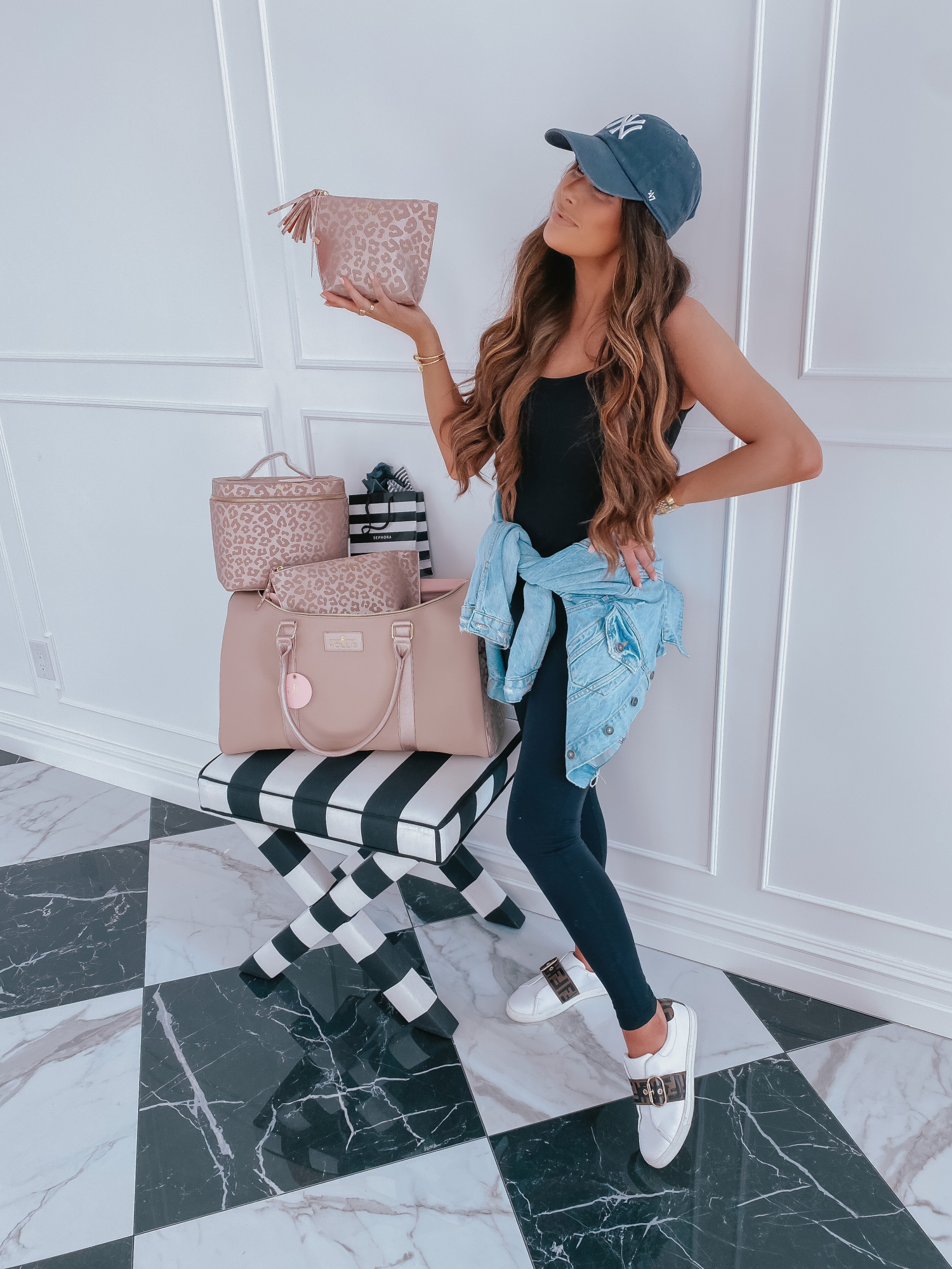 Cute Workout Clothes by popular US fashion blog, The Sweetest Thing: image of Emily Gemma wearing a Vince tank, Fendi sneakers, Zella leggings, Free People denim jacket, and a Urban Outfitters Yankies ball cap.
