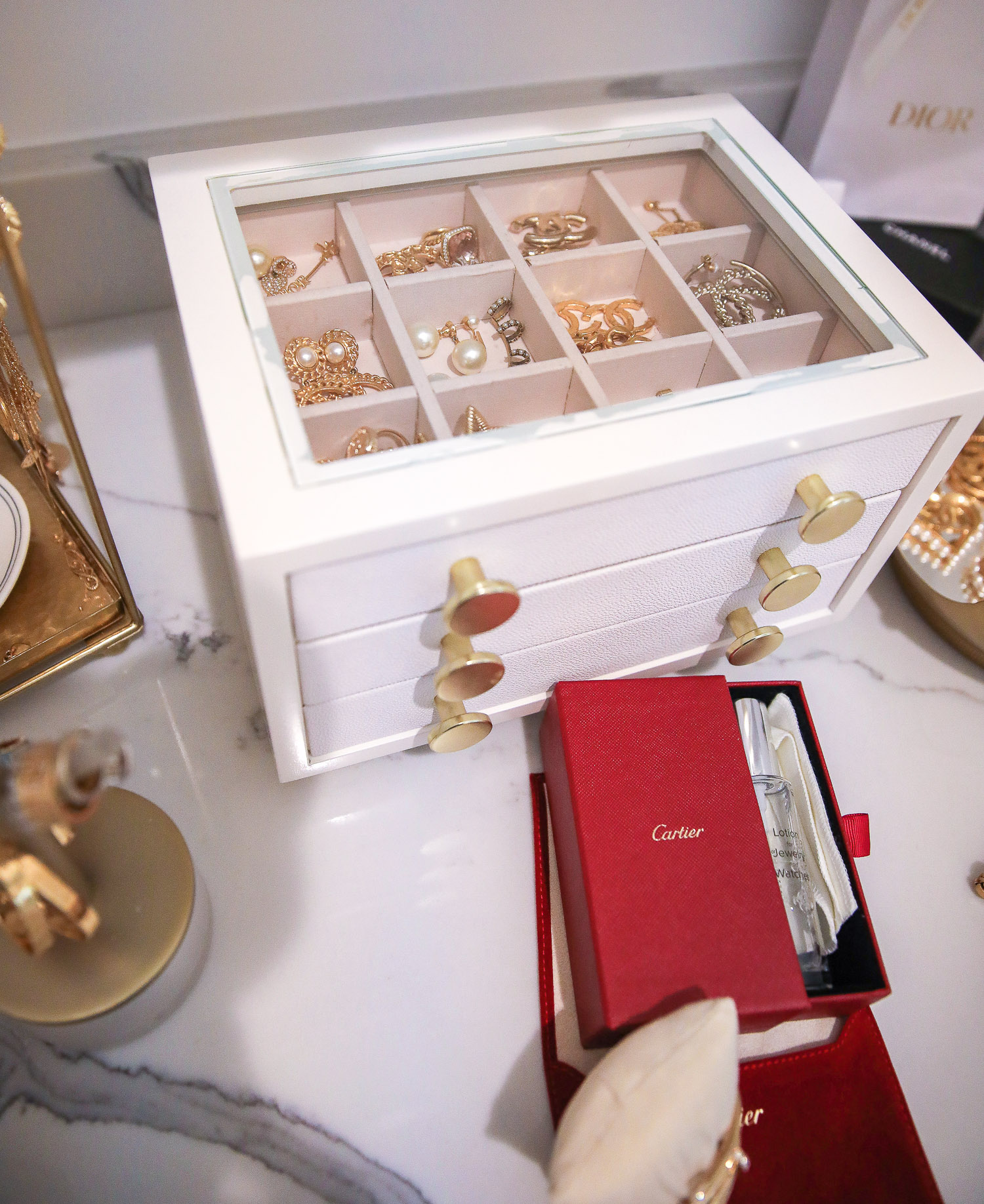 jewelry organization, how to store jewelry, Cartier jewelry cleaner | Nighttime Routine by popular US beauty blog, The Sweetest Thing: image of Cartier jewelry cleaner Chanel earrings in a Jewelry box.