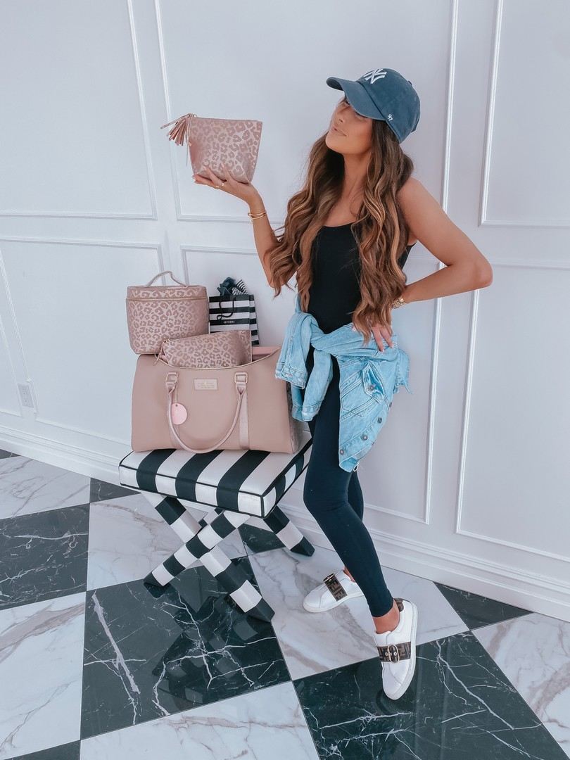Instagram Recap by popular US life and style blog, The Sweetest Thing: image of Emily Gemma wearing Zella leggins, Vince black top, denim jacket, Urban Outfitters New York Yankies hat, Frendi sneakers, and holding a leopard print Hollis bag.