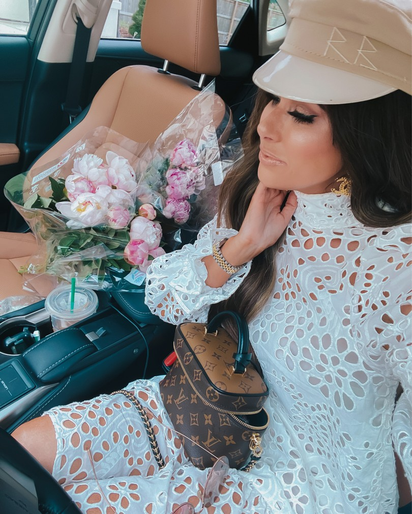 Instagram Recap by popular US life and style blog, The Sweetest Thing: image of Emily Gemma wearing a H&M white eyelet dress, Baker Boy Cap Ruslan Baginskiy, and holding a Louis Vuitton bag.
