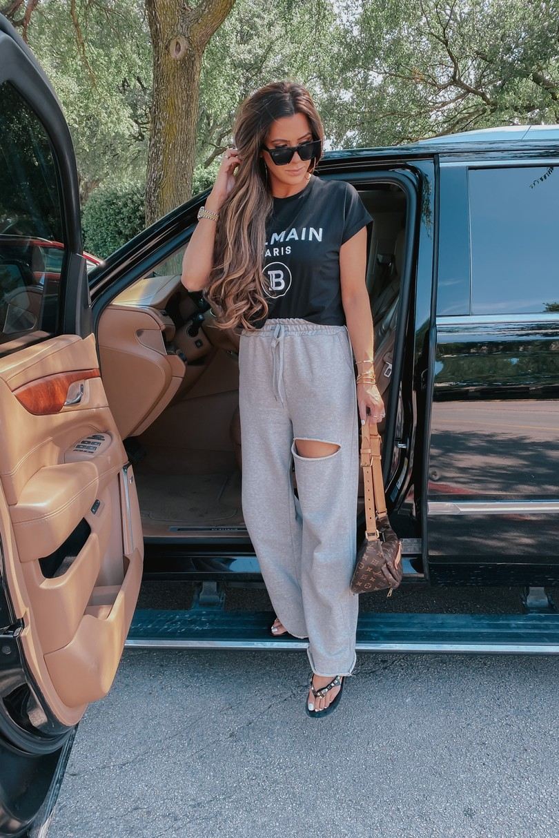 Instagram Recap by popular US life and style blog, The Sweetest Thing: image of Emily Gemma wearing a Balmain top, BP. sunglasses, Storets Nadia Slash Lounge Pants, Harmonic Studs Flip Flop MELISSA, and holding a Louis Vuitton bum bag.