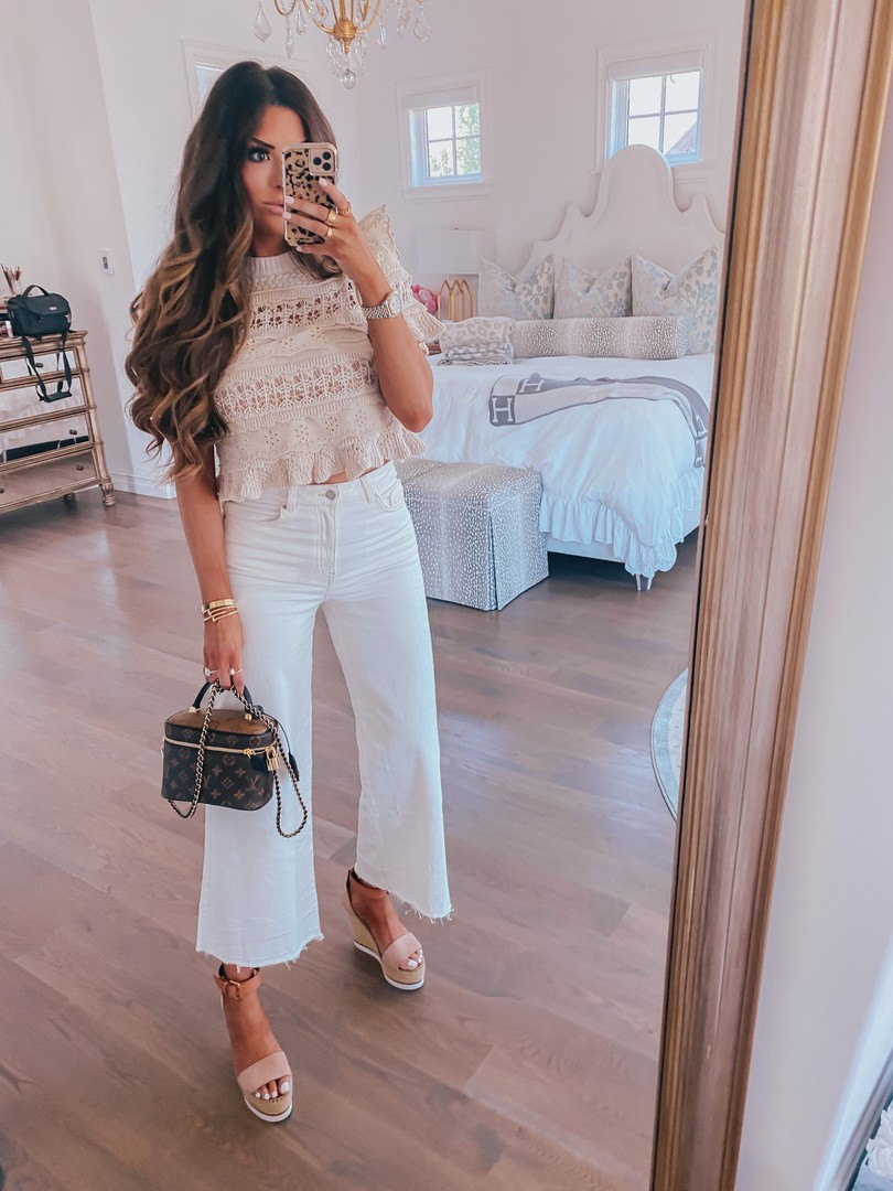 Instagram Recap by popular US life and style blog, The Sweetest Thing: image of Emily Gemma wearing a Zara top, See by Chloe wedges, white H&M jeans, and holding a Louis Vuitton bag.