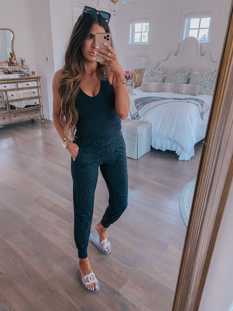 Instagram Recap by popular US life and style blog, The Sweetest Thing: image of Emily Gemma wearing a Alo top, Lululemon joggers, and Chanel slide sandals.