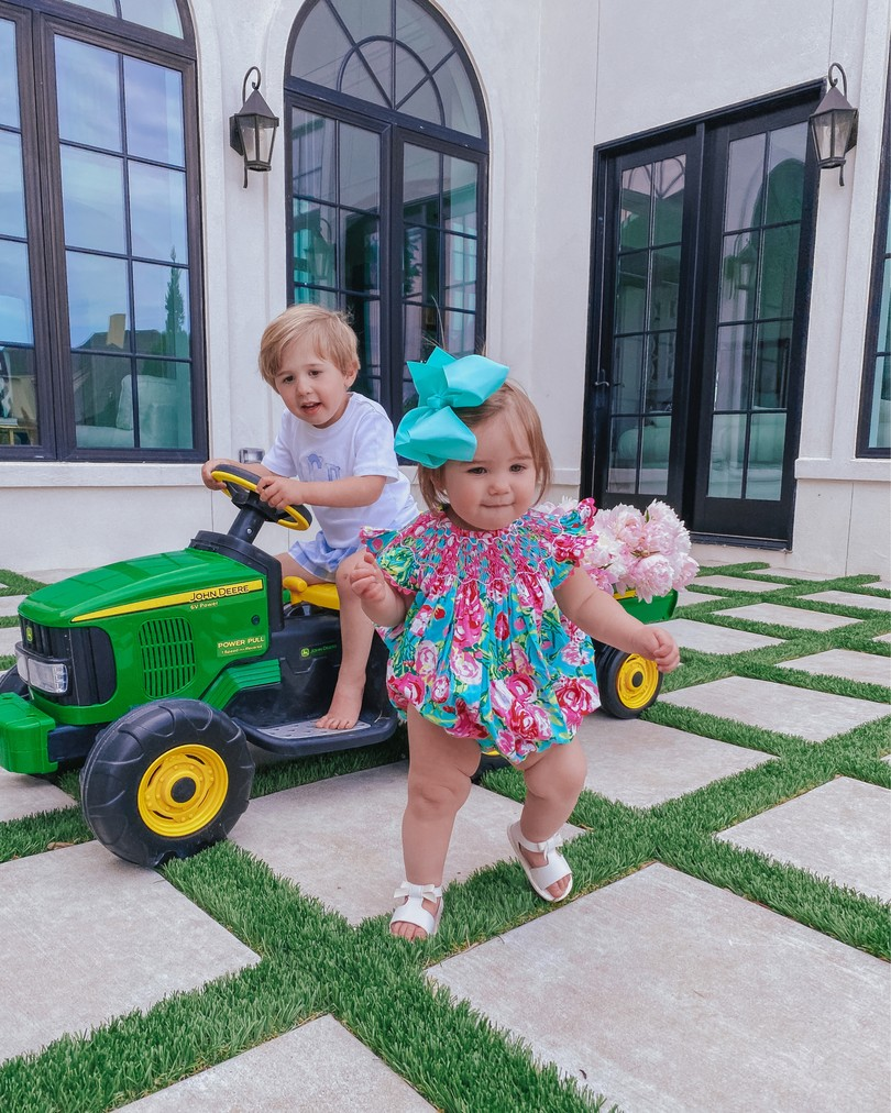 Instagram Recap by popular US life and style blog, The Sweetest Thing: image of Emily Gemma's son riding a Target John Deer tractor and her daughter Sophie wearing a Smocked Auctions romper .