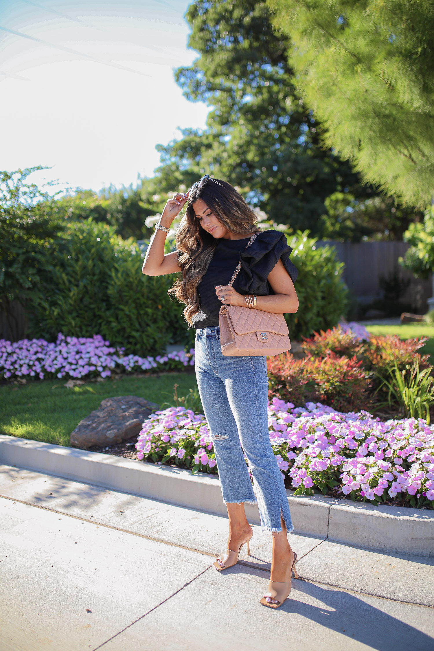 Express fashion june 2020, emily gemma, summer outfit idea pinterest 2020, best express jeans 2020, bottaga nude sandals | Date Night Outfit by popular US fashion blog, The Sweetest Thing: image of Emil Gemma wearing a Express Textured Jacquard Ruffle Sleeve Top, Express High Waisted Denim Perfect Frayed Cropped Flare Jeans, Express Thick Hoop Earrings, Bottega Veneta nude heel sandals, Cartier bracelets, BP. sunglasses, and holding a Chanel bag.
