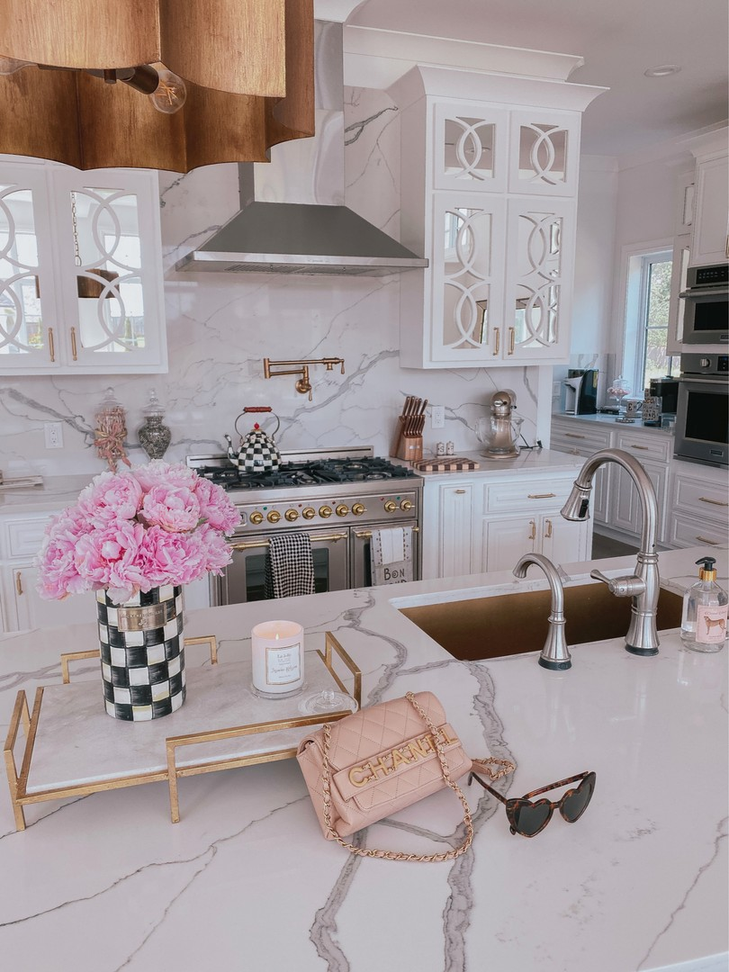 Instagram Recap by popular US life and style blog, The Sweetest Thing: image of Emily Gemma wearing a Mackenzie Child tea kettle, Mackenzie Childs flower vase, World Market hand soap, Saint Laurent sunglasses, Cambridge knives, Anthropologie candle, and a Channel purse