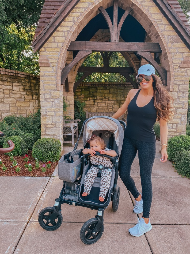 Instagram Recap by popular US life and style blog, The Sweetest Thing: image of Emily Gemma pushing her daughter in a Bugaboo stroller and wearing a Alo top, Lululemon leggings, Nike hat, and Adidas sneakers.