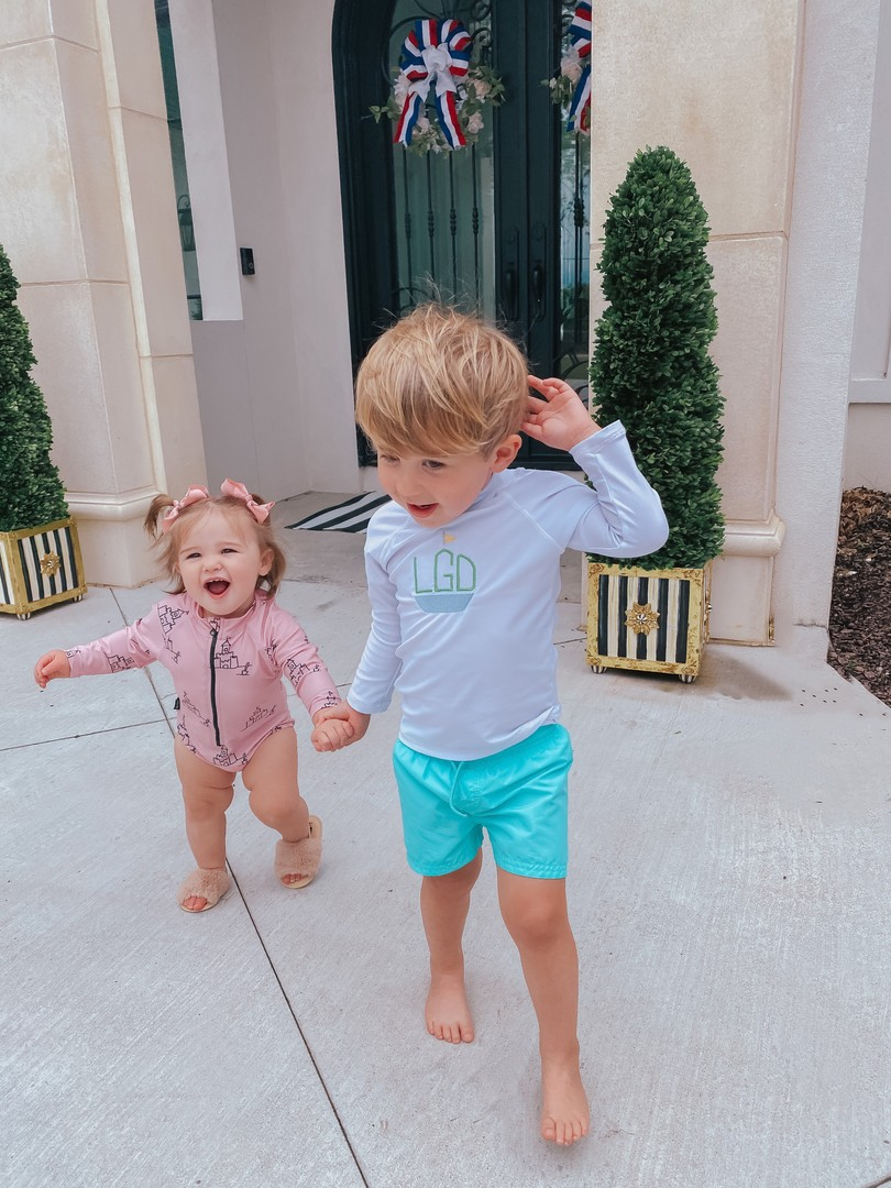 Instagram Recap by popular US life and style blog, The Sweetest Thing: image of Emily Gemma's son and daughter holding hands outside while standing next to Mackenzie Childs planters and wearing a Tiny tribe swimsuits