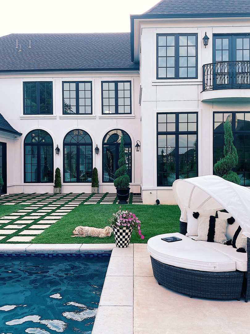 Instagram Recap by popular US life an style blog, The Sweetest Thing: image of a backyard with a pool, and Sol 72 Outdoor daybed.