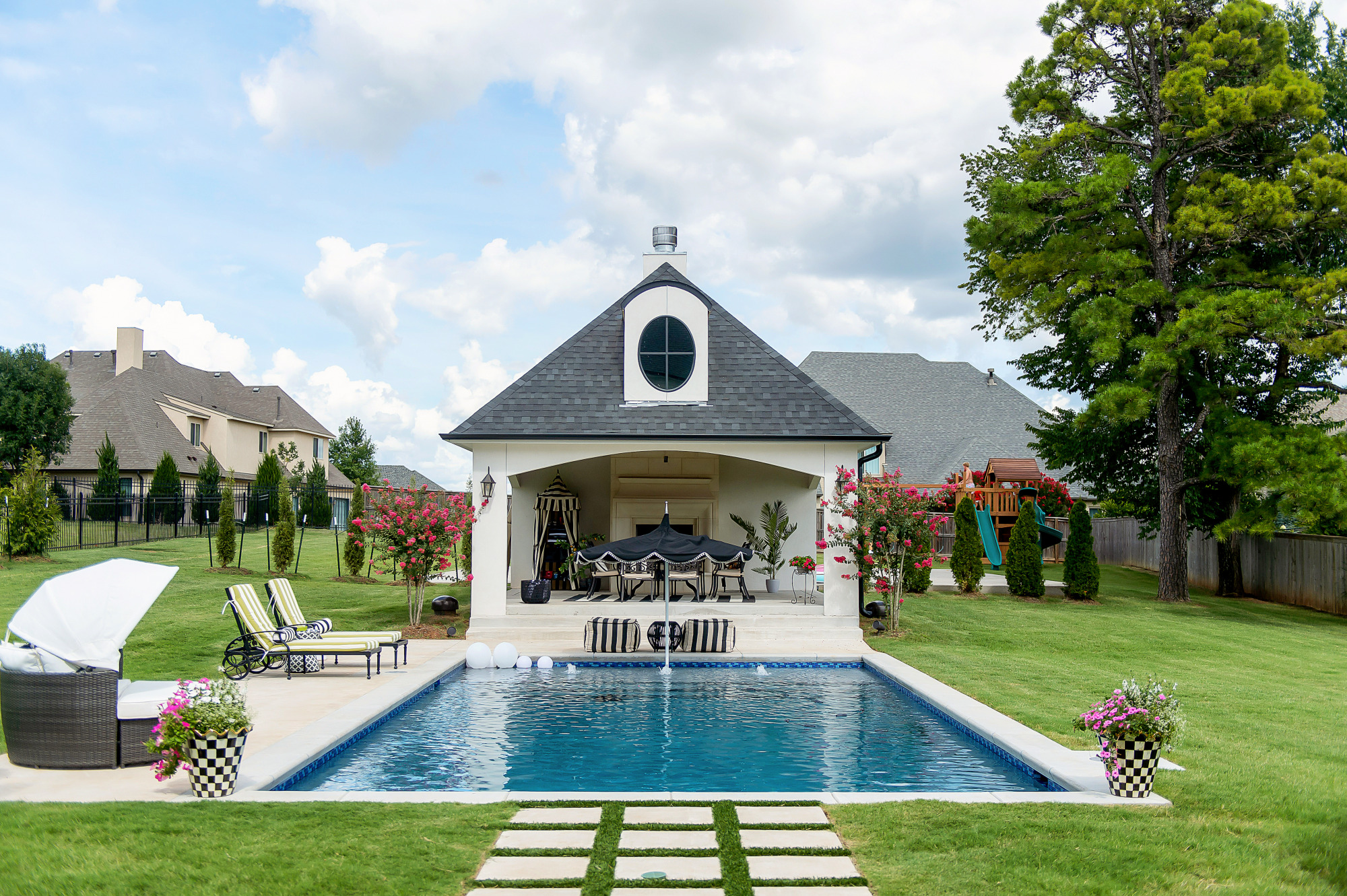 Blog Design by popular US lifestyle blog, The Sweetest Thing: image of a outdoor swimming pool with a pool house.