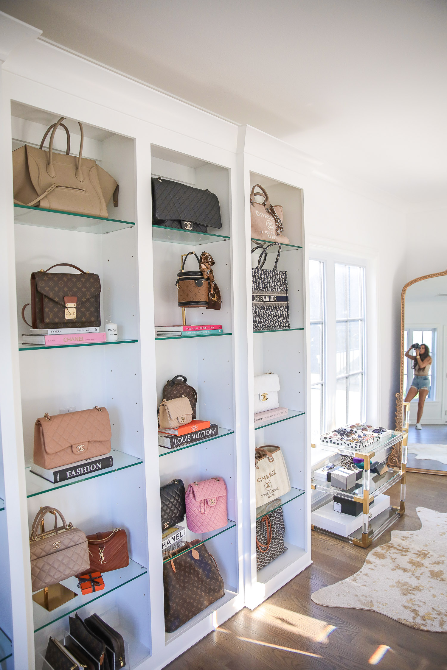 amazon must haves summer 2020, amazon home decor blog post, amazon luxury must haves, two story closet pinterest, emily gemma, closet organization | Amazon Favorites by popular US life and style blog, The Sweetest Thing: image of various designer purses, a gold hat stand, and various coffee table fashion books.