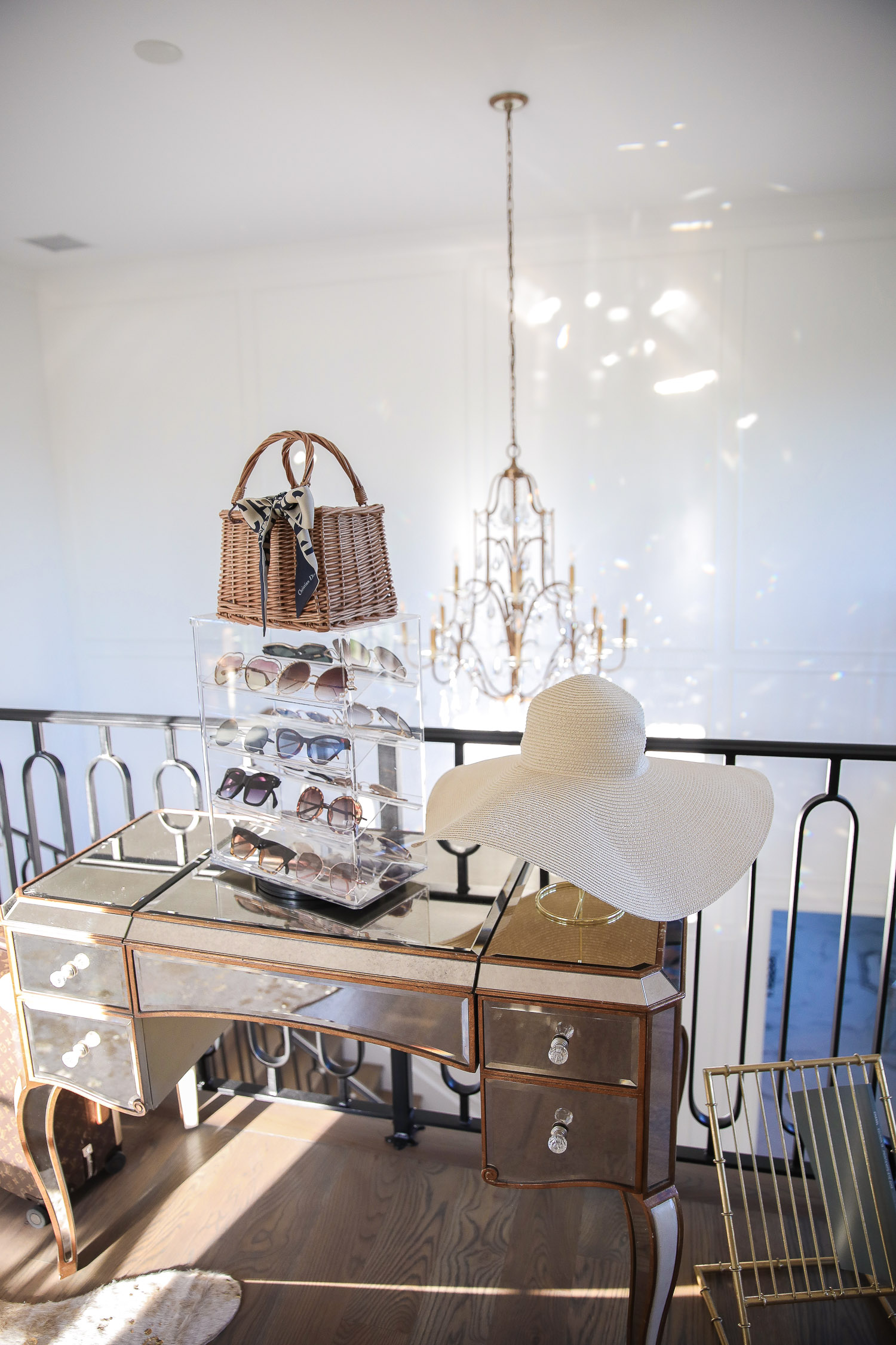 amazon must haves summer 2020, amazon home decor blog post, amazon luxury must haves, two story closet pinterest, emily gemma, closet organization | Amazon Favorites by popular US life and style blog, The Sweetest Thing: image of a Amazon MOOCA Lockable Showcase Rotating Acrylic Display Stand with 4 Removable Shelves and a Amazon QTMY Bow Rattan Woven Bag Straw Bags Top Handle Handbags Bohemia Style Beach Bag next to a Amazon MyGift 14-Inch Brass-Tone Wire Tabletop Hat Stand with a oversized sunhat on a Wayfair Reid Jewelry Vanity