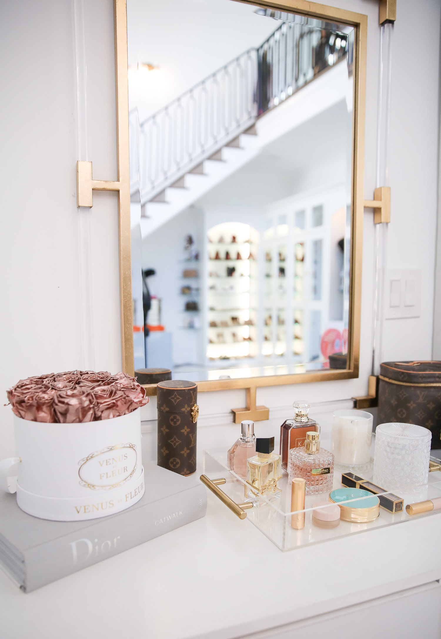 amazon must haves summer 2020, amazon home decor blog post, amazon luxury must haves, two story closet pinterest, emily gemma, closet organization | Amazon Favorites by popular US life and style blog, The Sweetest Thing: image of a gold frame mirror, Dior book, and acrylic tray containing makeup and various perfumes.