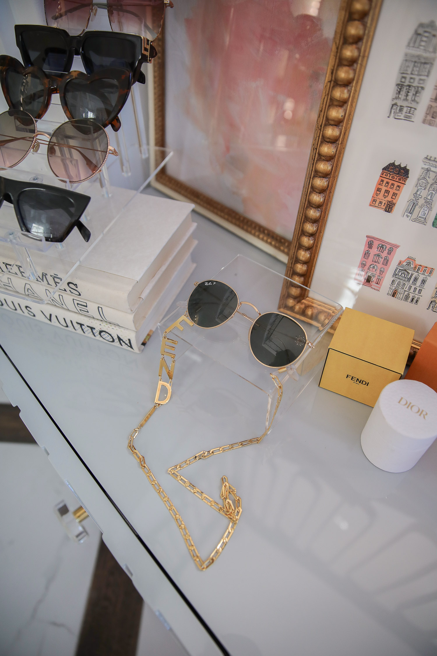 amazon must haves summer 2020, amazon home decor blog post, amazon luxury must haves, two story closet pinterest, emily gemma, closet organization | Instagram Recap by popular US life an style blog, The Sweetest Thing: image of a Fendi sunglasses chain, Acrylic sunglasses stand, Nordstrom stacked books, Amazon sunglasses, Gucci, Sunglasses, Dior Sunglasses, YSL sunglasses, Louis Vuitton sunglasses, Dior candle, and Parisian building art.