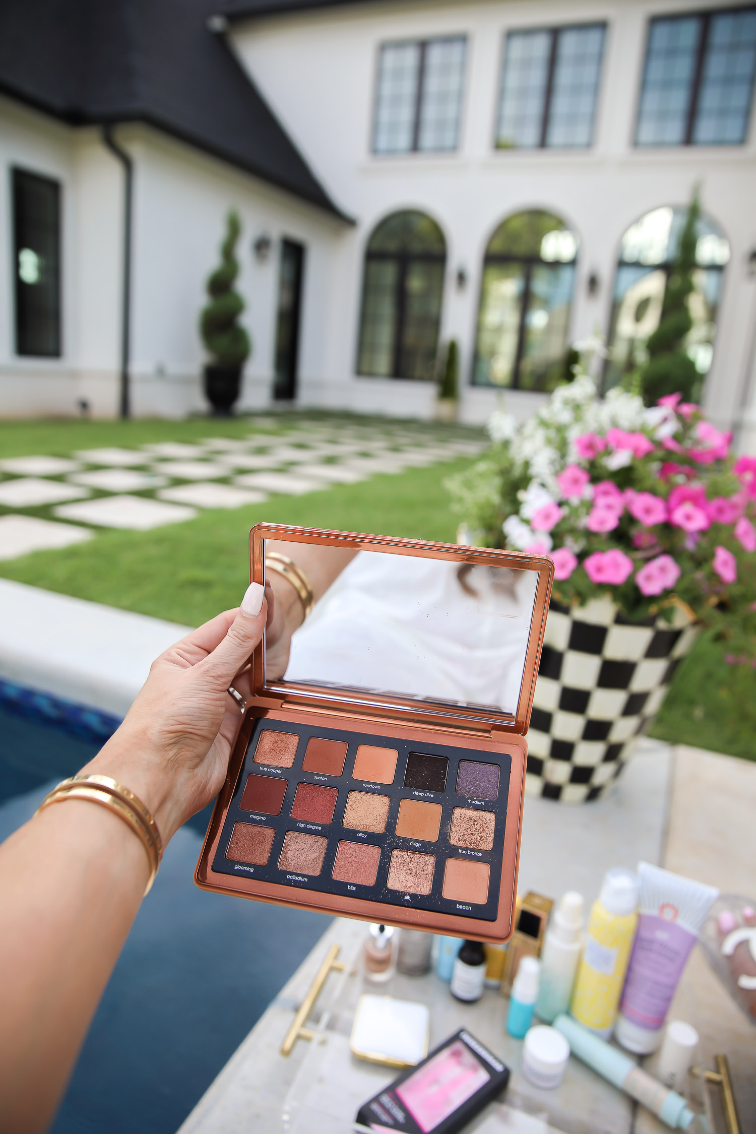 sephora haul beauty blogger july 2020, natasha denona bronze palette review, best dry shampoo at sephora, tarte SPF powder, emily gemma house | Sephora Favorites by popular US beauty blog, The Sweetest Thing: image of Emily Gemma holding a eyeshadow pallet.