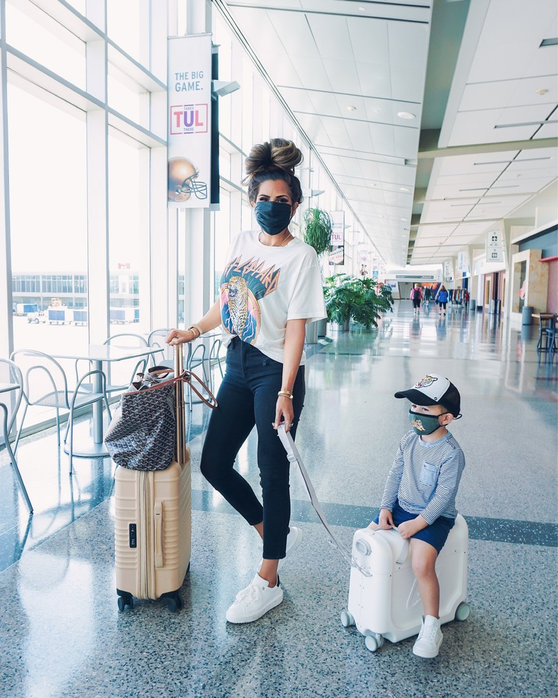 Travel Outfits, Jetkids, Cute Face masks, NSALE 2020, Nordstrom Sale Outfits, Emily Ann Gemma  Instagram Recap by popular US life and style blog, The Sweetest Thing: image of Emily Gemma with her son at the airport and wearing a Daydreamer t-shirt, Steve Madden sneakers, Slip face mask and Lana Jewelry earrings and necklace.