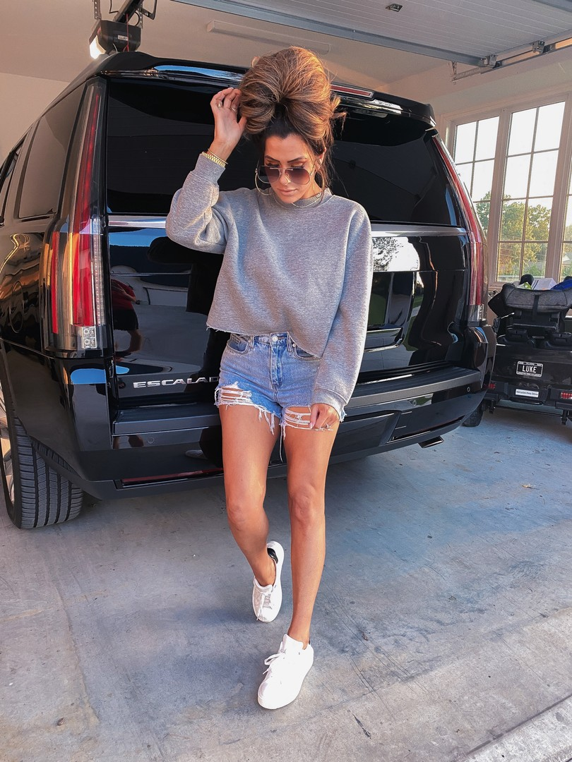 Fall transition outfits, Best of NSALE 2020, Casual outfits, Emily Ann Gemma  Instagram Recap by popular US life and style blog, The Sweetest Thing: image of Emily Gemma wearing a pair of Steve Madden sneakers, Top Shop sweatshirt, and BlankNYC shorts.