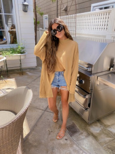 summer fashion 2020, free people, beach outfits, Emily Ann Gemma  Instagram Recap by popular US life and style blog, The Sweetest Thing: image of Emily Gemma wearing a BlankNYC top, cutoff denim shorts and studded sandals.