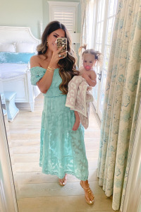summer fashion 2020, maxi Dress, beach outfits, Emily Ann Gemma  Instagram Recap by popular US life and style blog, The Sweetest Thing: image of Emily Gemma holding her daughter wrapped in a Barefoot Dreams blanket and wearing a Rahi dress, Chanel shoes, Cartier ring, and Rolex watch.