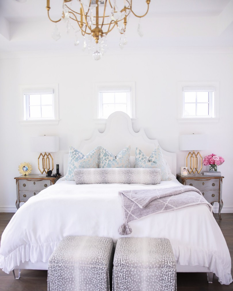 home decor, nsale home finds, Nordstrom sale home decor, Emily Ann Gemma, Bright white bedroom ideas  Instagram Recap by popular US life and style blog, The Sweetest Thing: image of a master bedroom decorated with a My Chic Nest bed, gold lamps, grey night stands, antelope print ottomans, white duvet, and gold and crystal chandelier.