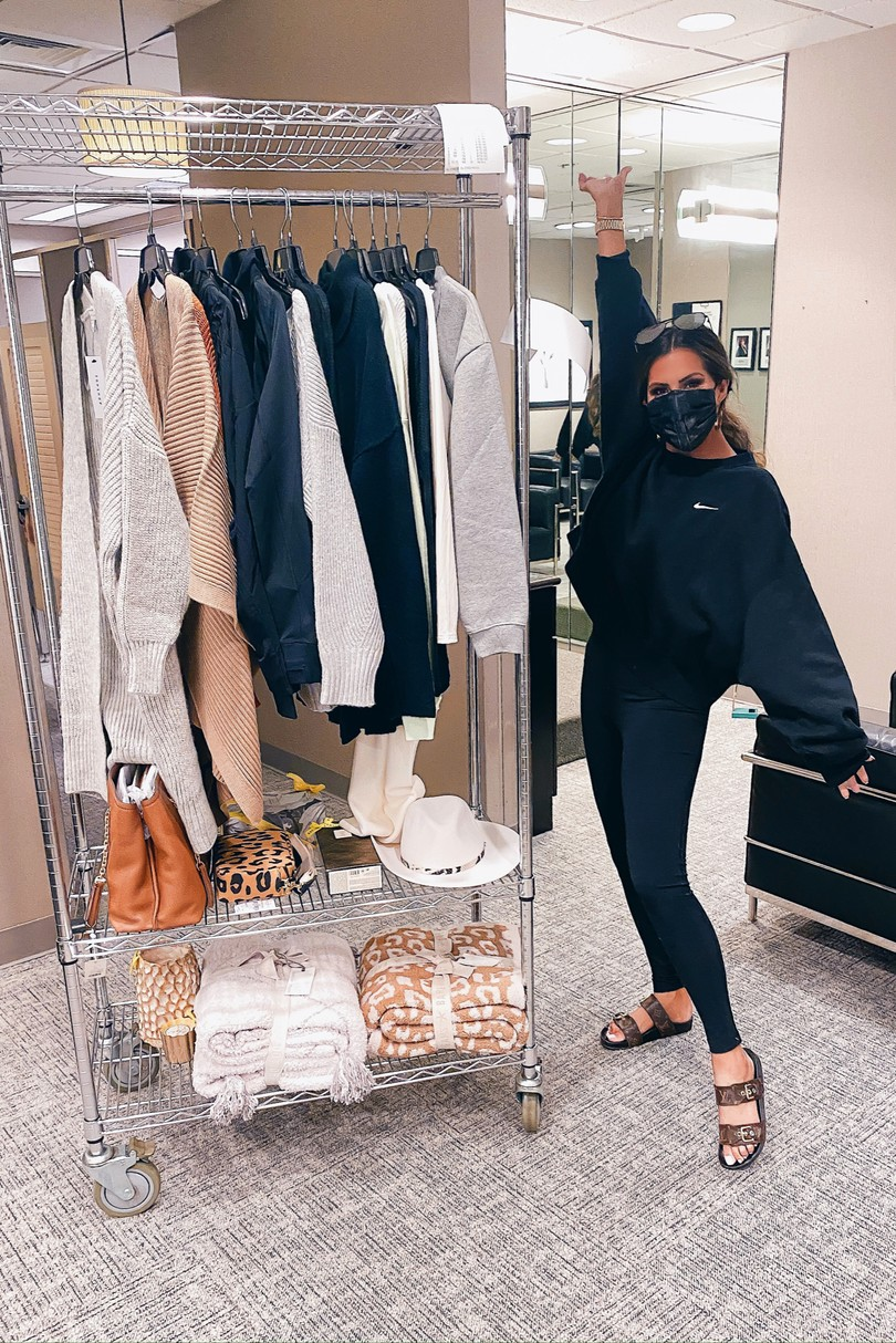 NSALE 2020, Nordstrom Sale try on, Fall Fashion, Emily Ann Gemma  Instagram Recap by popular US life and style blog, The Sweetest Thing: image of Emily Gemma standing next to a clothing rack and wearing a Nike sweatshirt, Zella leggings, and a Slip face mask.