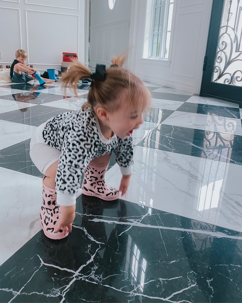 NSALE 2020, Baby outfits, Hunter Rain Boots, Emily Ann Gemma  Instagram Recap by popular US life and style blog, The Sweetest Thing: image of a little girl wearing a black and white leopard print top and pink and black leopard print Hunter boots.