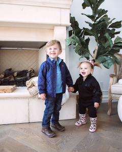 Nsale 2020, Baby Fashion, Toddler outfits, Nordstrom Sale 2020, Emily Ann Gemma  Instagram Recap by popular US life and style blog, The Sweetest Thing: image of two kids standing together and holding hands and wearing a Patagonia jacket, black two piece set, pink leopard print rain boots, brown shoes.