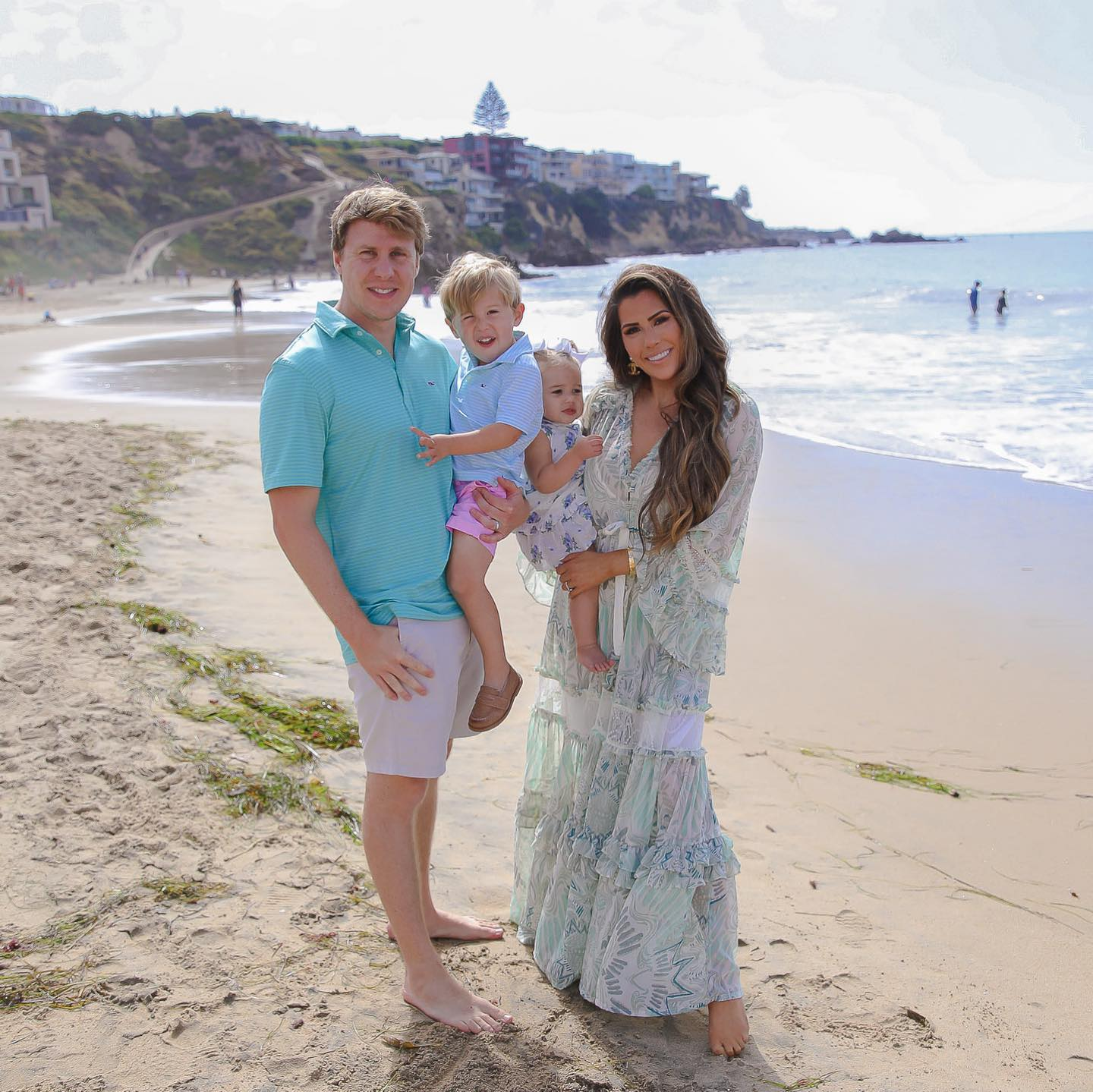Instagram Recap by popular US lifestyle blog, The Sweetest Thing: image of Emily Gemma and her husband and kids standing together in the sand next to the ocean.