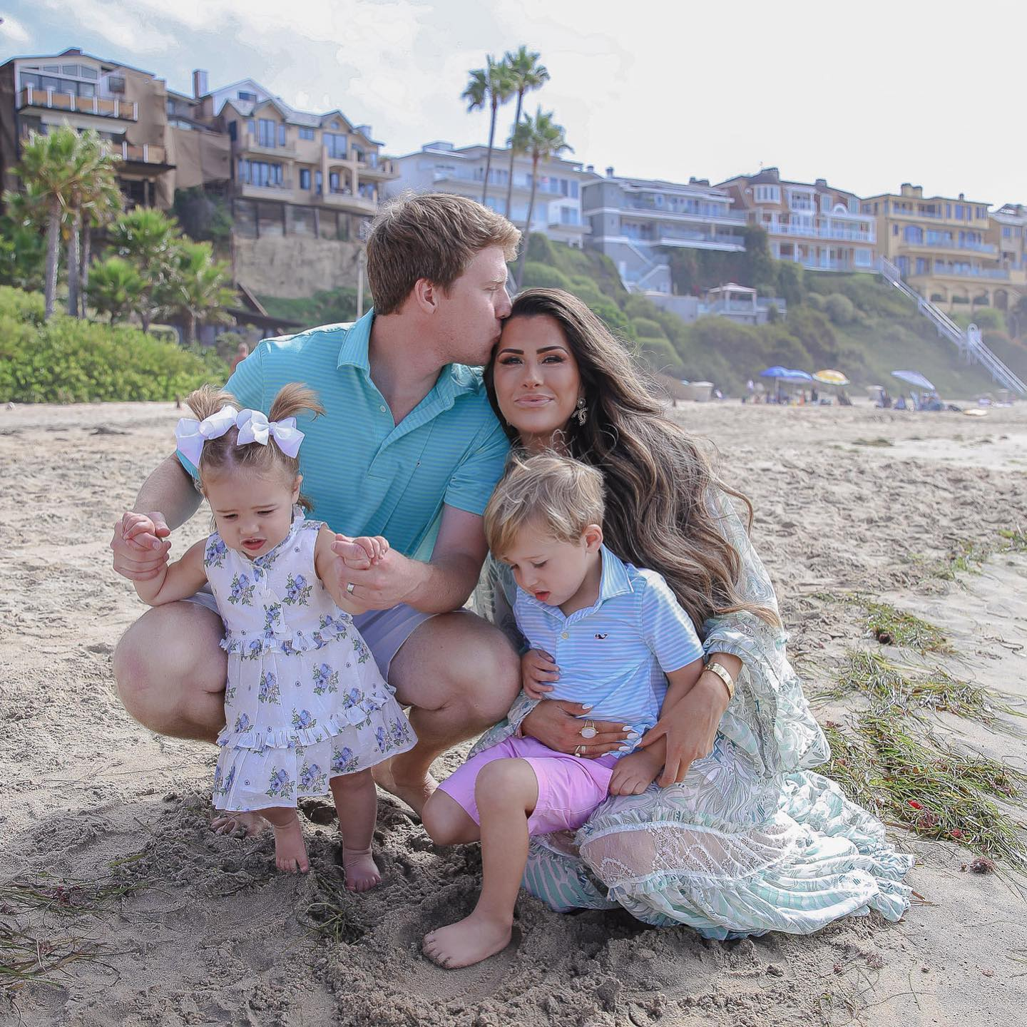 Instagram Recap by popular US lifestyle blog, The Sweetest Thing: image of Emily Gemma and her husband and kids kneeling together in the sand at the beach.